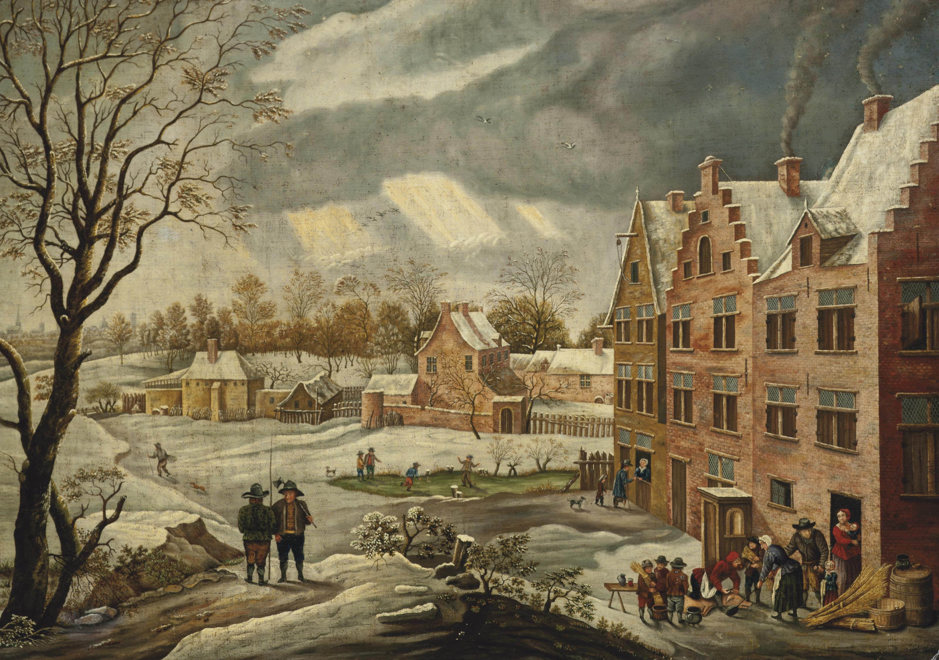 A winter landscape of a village with figures conversing on a track and figures skating on a frozen lake