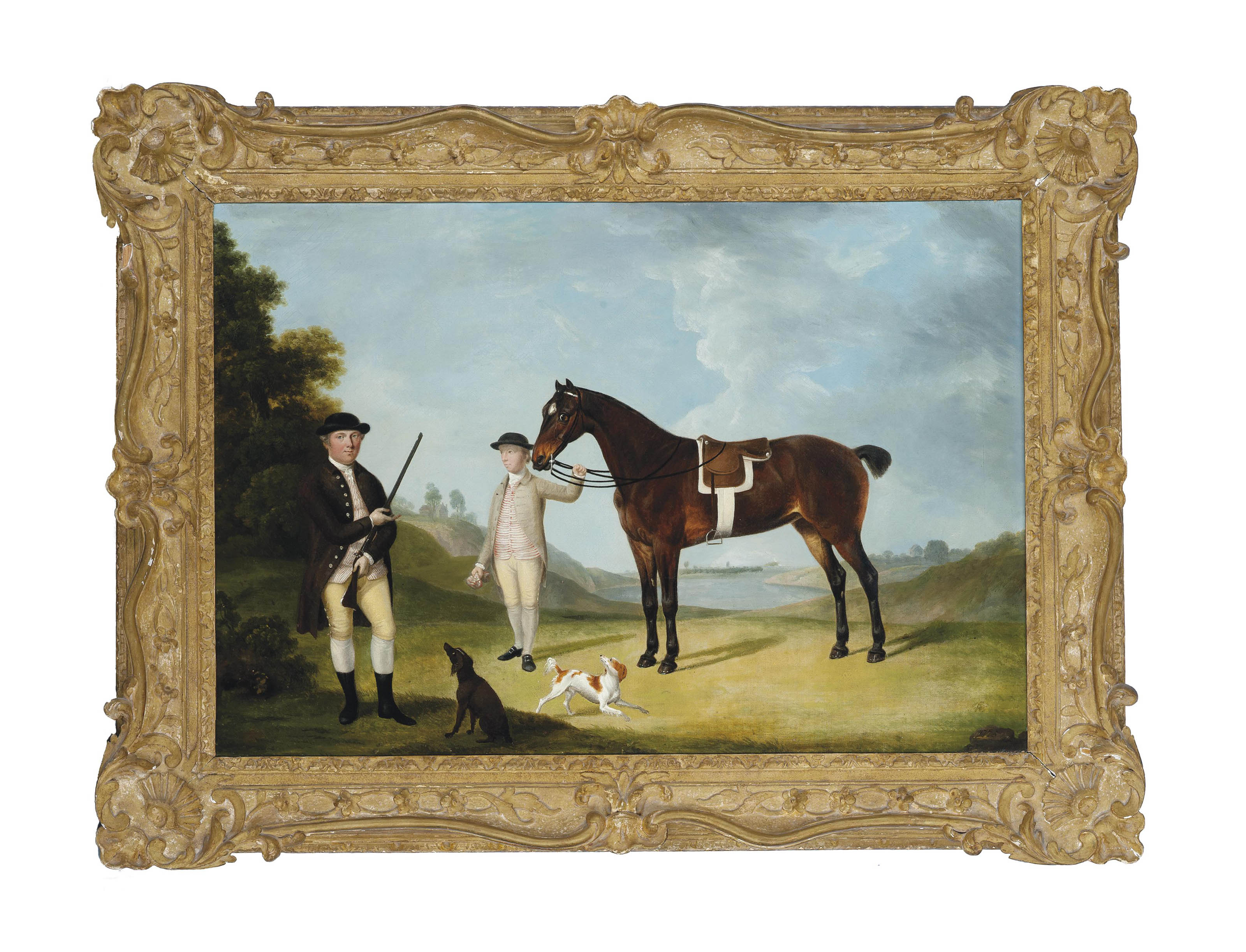 A gentleman and his hounds in an extensive landscape, his groom holding the reins of his chestnut hunter