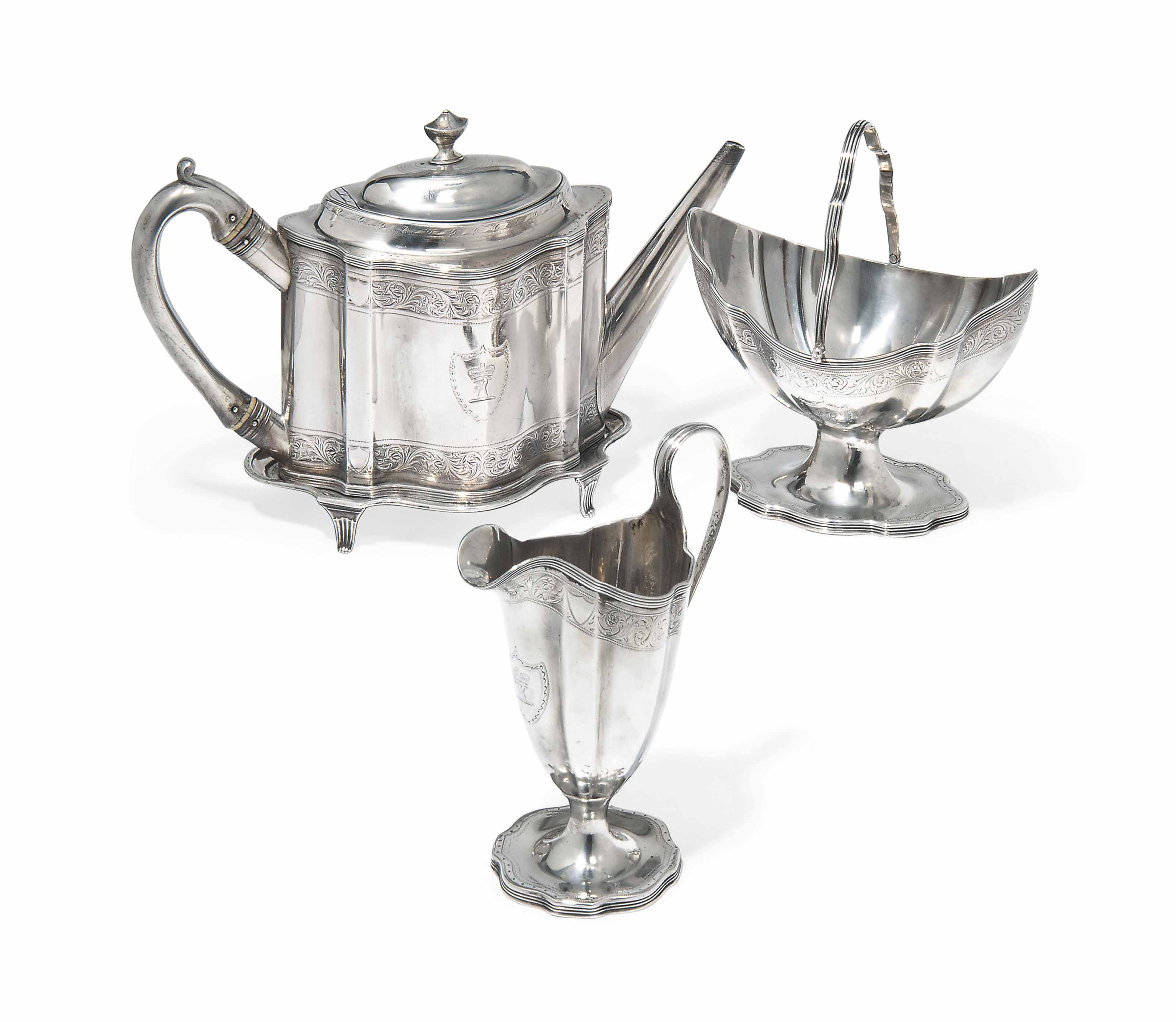 A GEORGE III SILVER TEAPOT AND STAND WITH SUGAR BASKET AND CREAM JUG EN SUITE