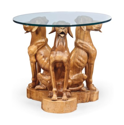 A CARVED HARDWOOD CENTRE TABLE