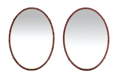A PAIR OF GLASS MOUNTED OVAL M