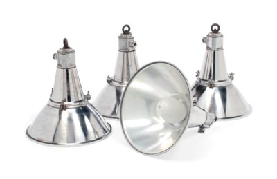 A SET OF FOUR POLISHED-METAL N
