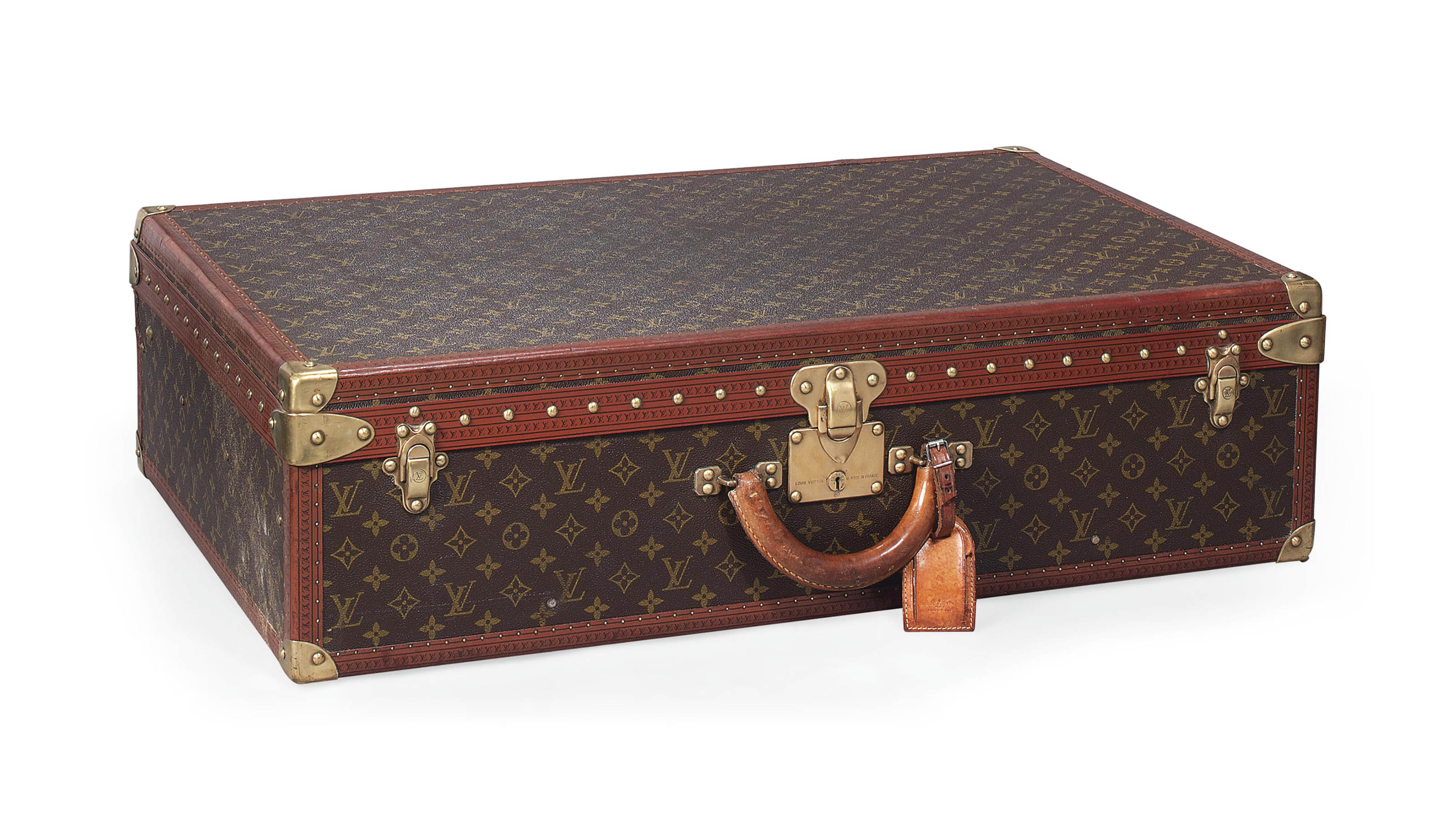 an alzer suitcase in monogram canvas louis vuitton probably mid 20th century christie 39 s. Black Bedroom Furniture Sets. Home Design Ideas
