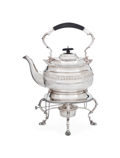 A SILVER KETTLE ON STAND