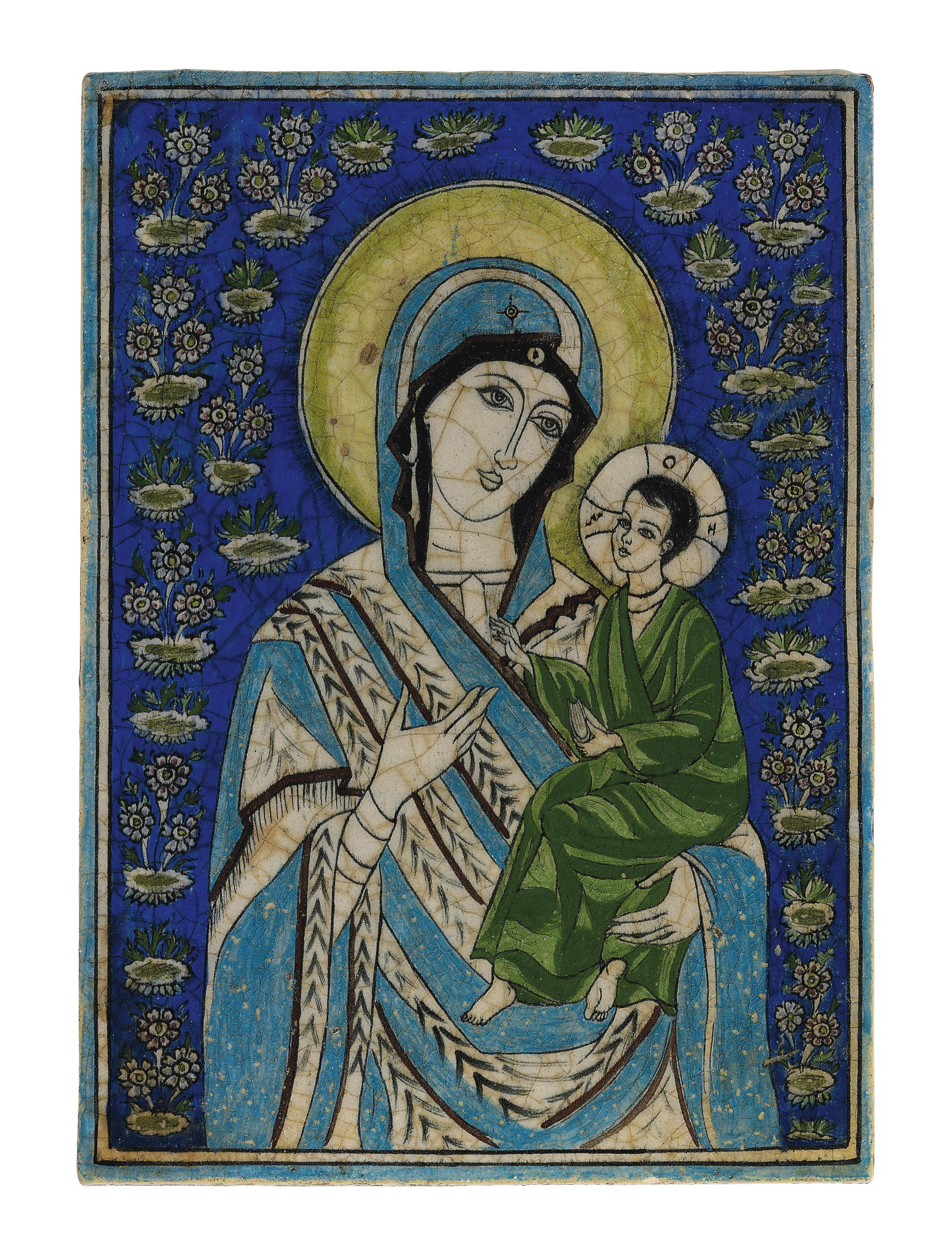 A QAJAR POTTERY TILE WITH THE VIRGIN MARY AND CHILD