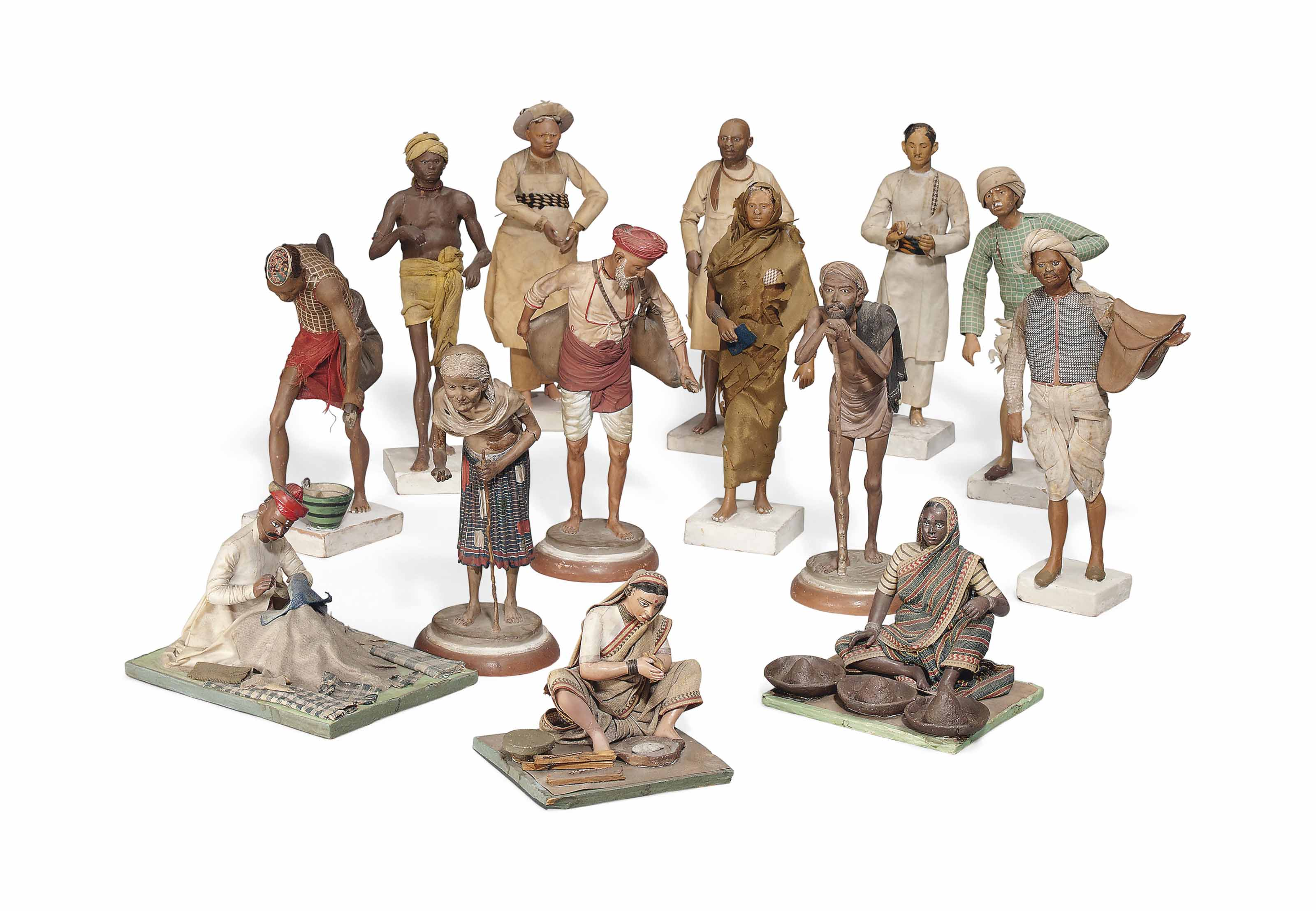 A GROUP OF FOURTEEN INDIAN TERRACOTTA FIGURES