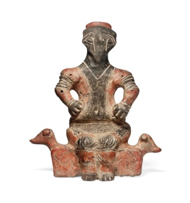 A VINCA TERRACOTTA SEATED MALE