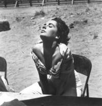 Elizabeth Taylor sunning herself on the set of 'Giant', Marfa, Texas, 1955