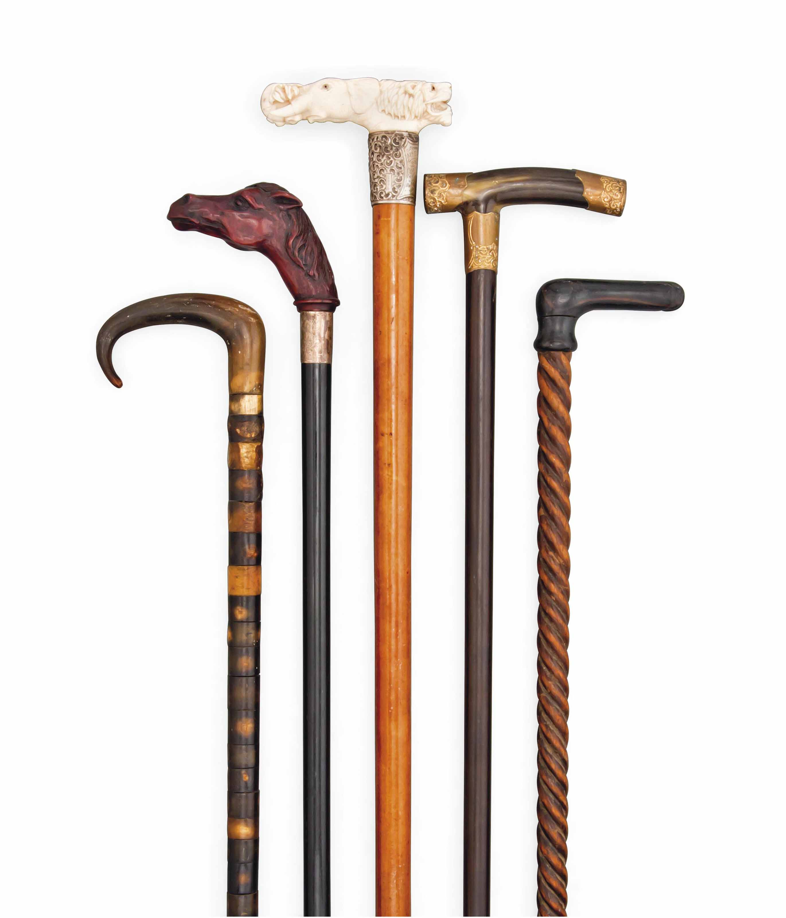 FIVE NOVELTY WALKING STICKS