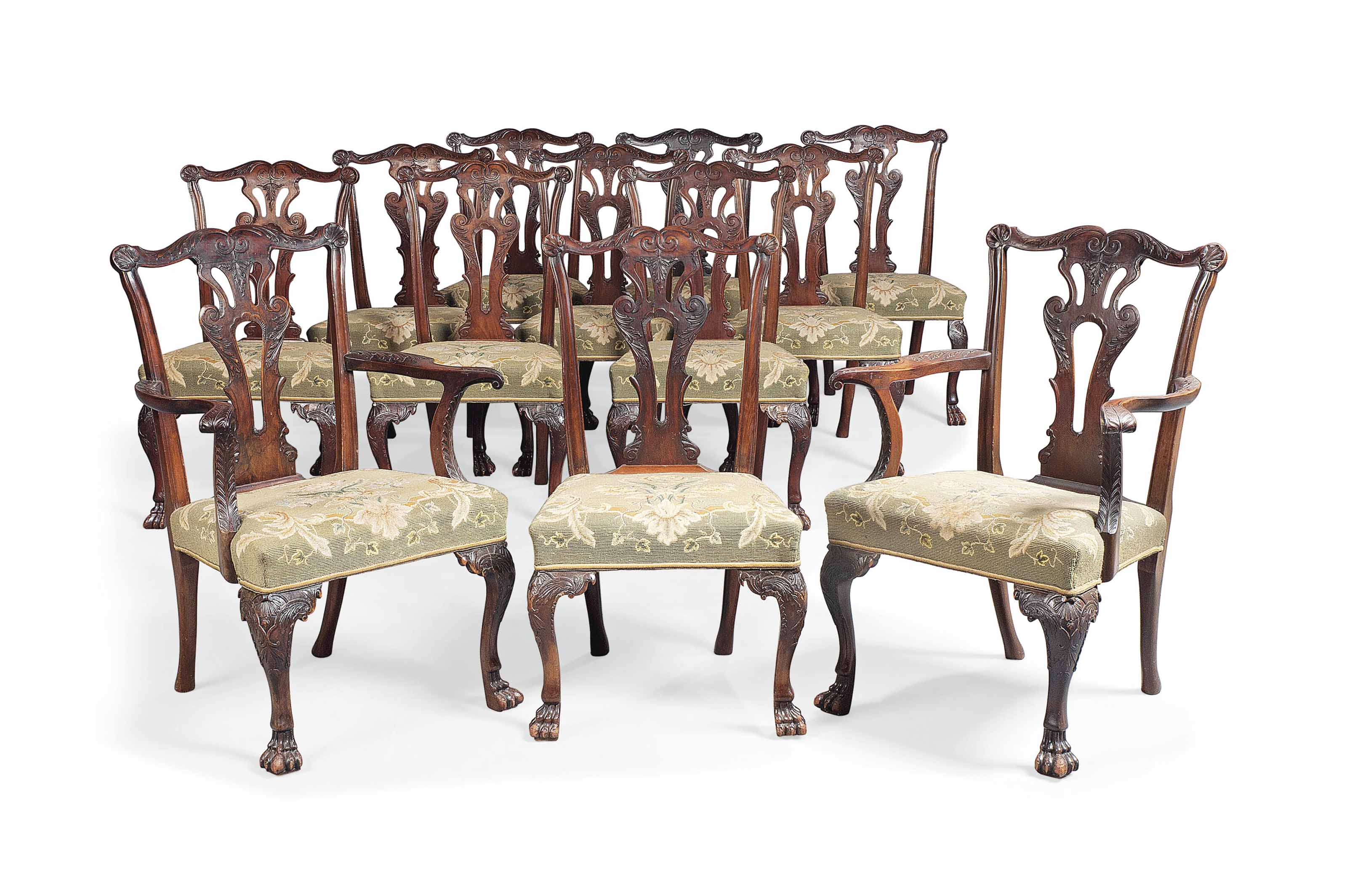 A SET OF TWELVE IRISH LATE VICTORIAN MAHOGANY DINING CHAIRS