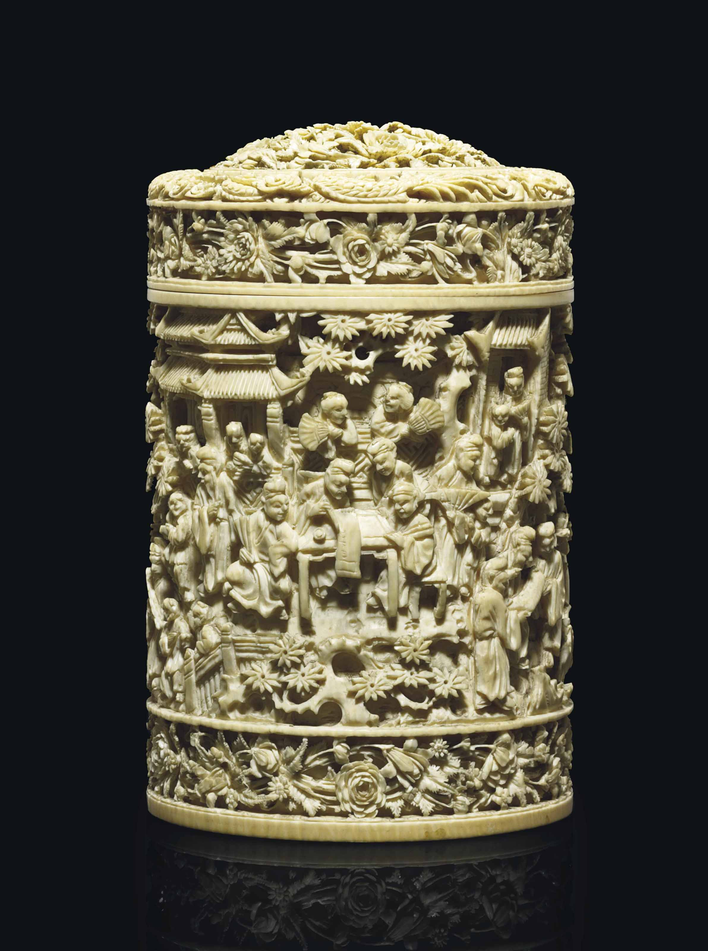 A CHINESE CARVED IVORY CYLINDRICAL BOX AND COVER