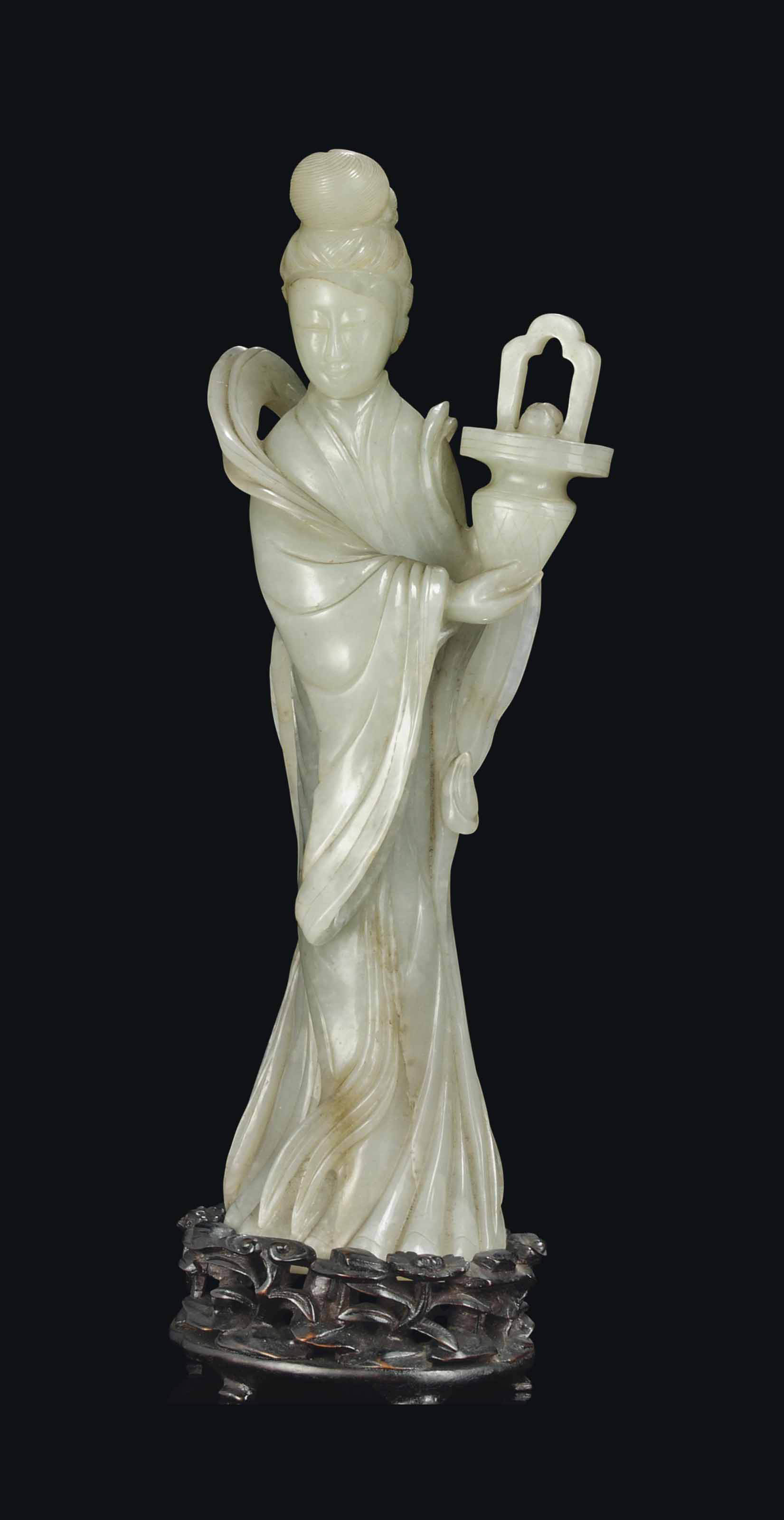 A CHINESE JADEITE MODEL OF A STANDING GUANYIN