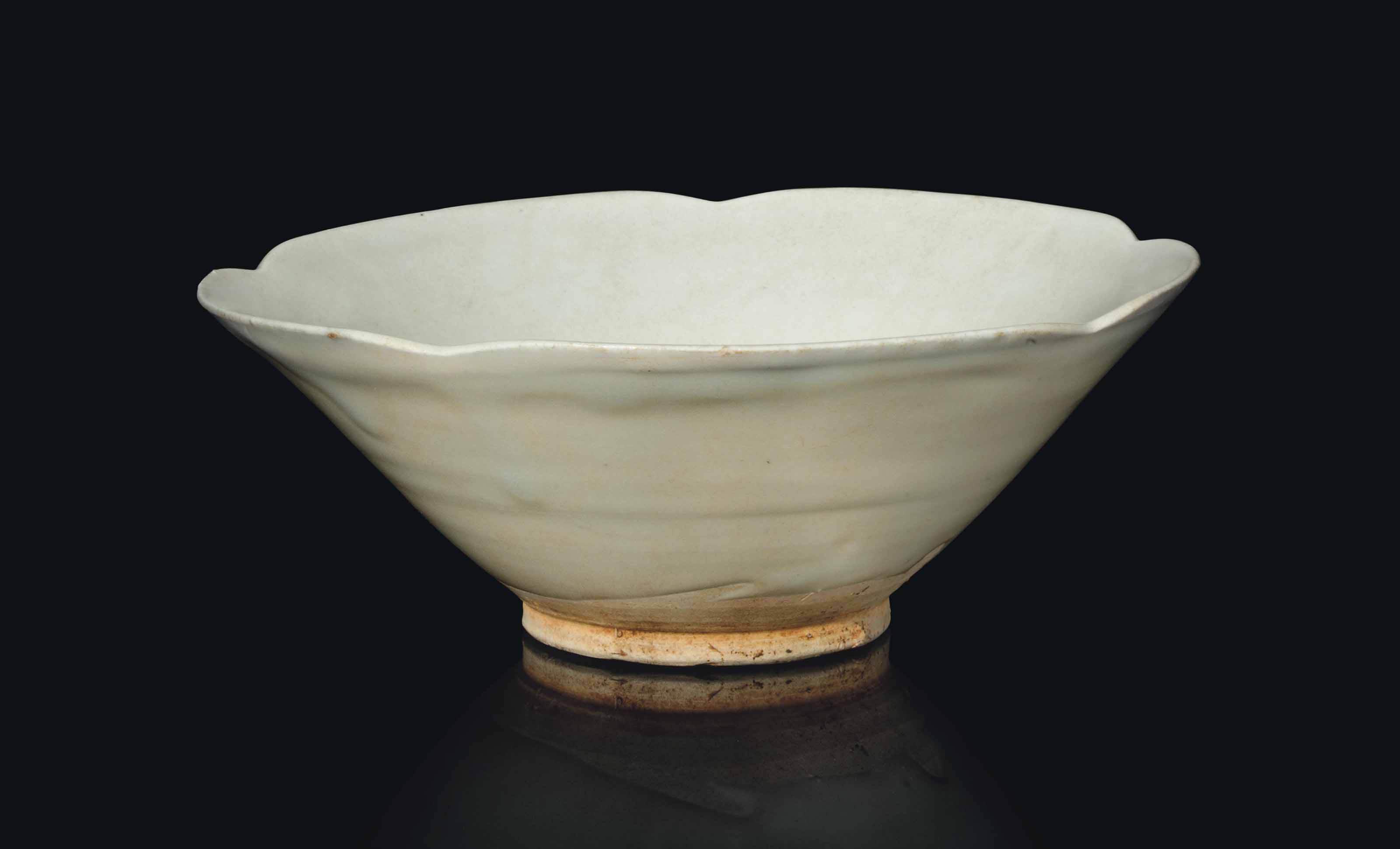 A CHINESE WHITE-GLAZED BOWL