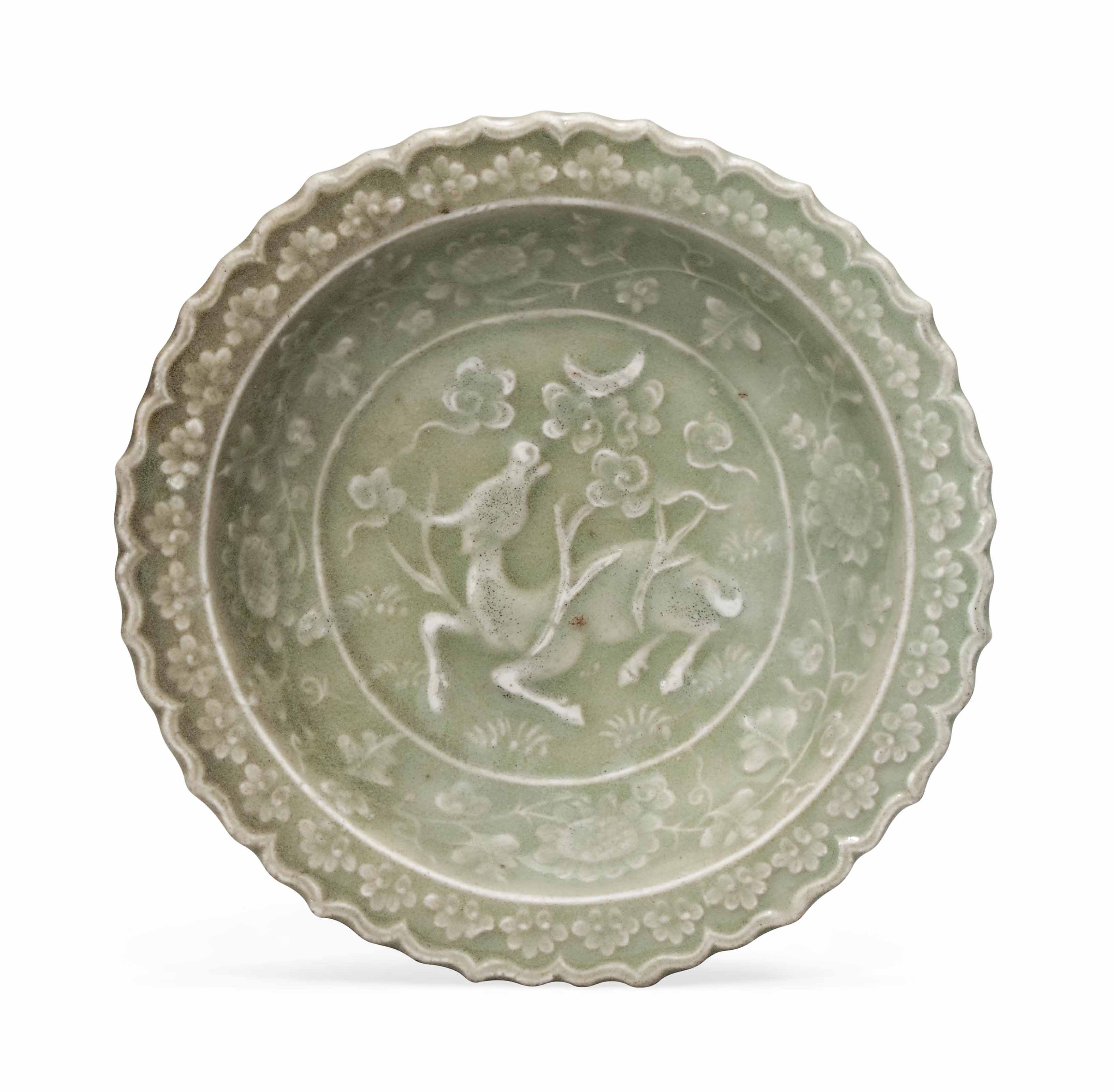 A SMALL CHINESE CARVED CELADON DISH