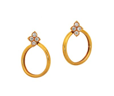 A pair of diamond earhoops, by