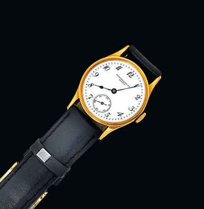 A gold wristwatch, by Patek Ph
