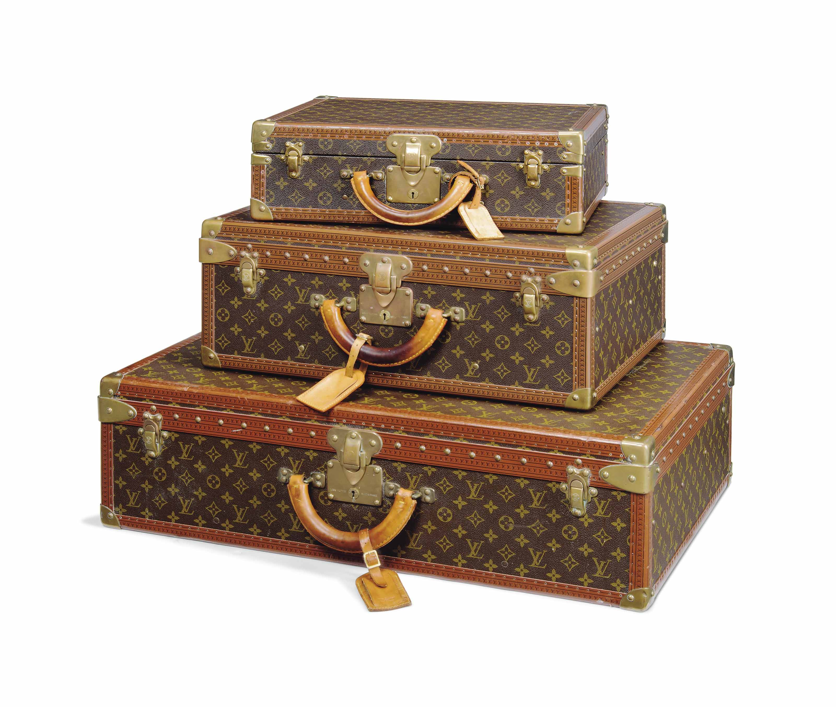 A GROUP OF THREE SUITCASES