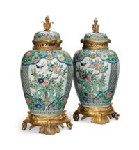 A LARGE PAIR OF GILT-BRONZE-MOUNTED FAMILLE VERTE POT-POURRI JARS AND FIXED COVERS