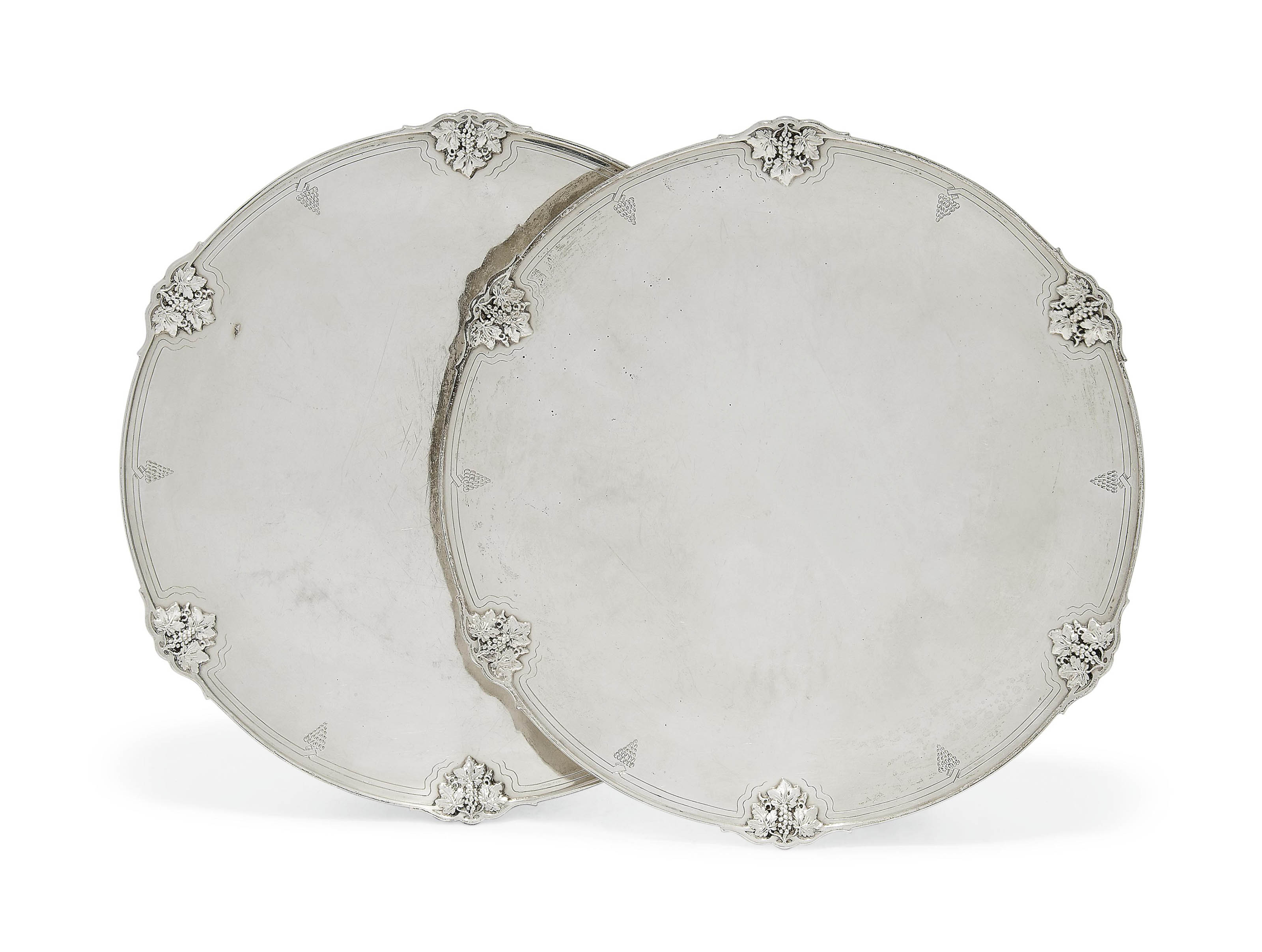 A PAIR OF SILVER DISHES