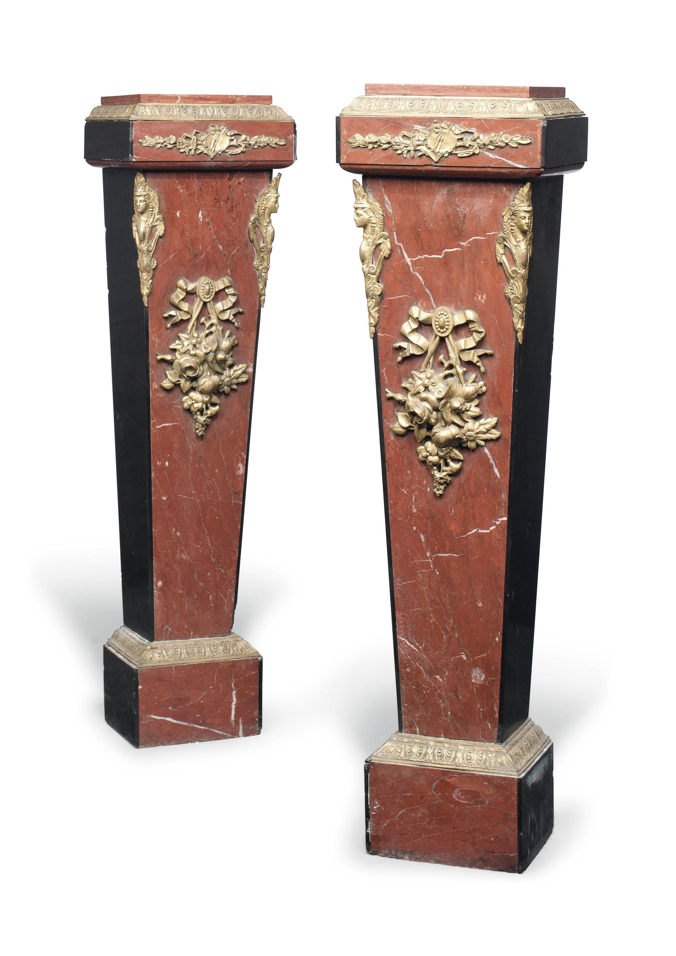 A PAIR OF CONTINENTAL ROUGE AND BLACK MARBLE AND GILT BRONZE MOUNTED PEDESTALS