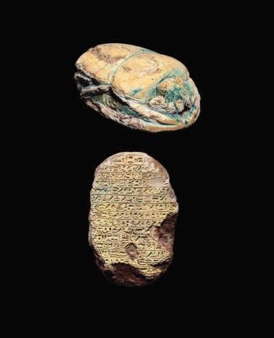 AN EGYPTIAN GREEN GLAZED STEAT