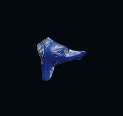 AN EGYPTIAN BLUE GLASS ANUBIS