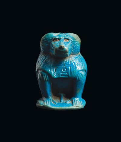 AN EGYPTIAN BLUE FAIENCE KHONS