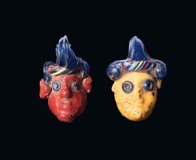 TWO PHOENICIAN GLASS HEAD PEND