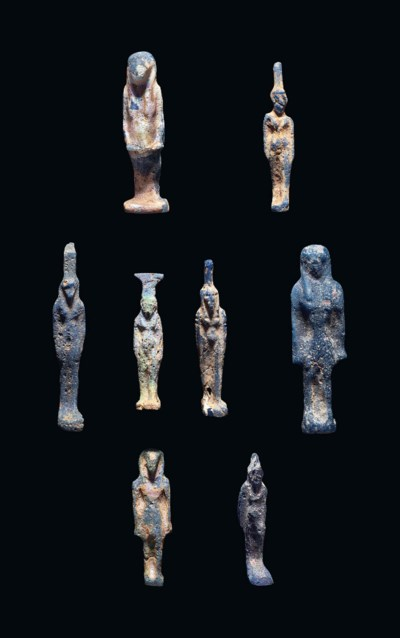 EIGHT EGYPTIAN BLUE GLASS DEIT