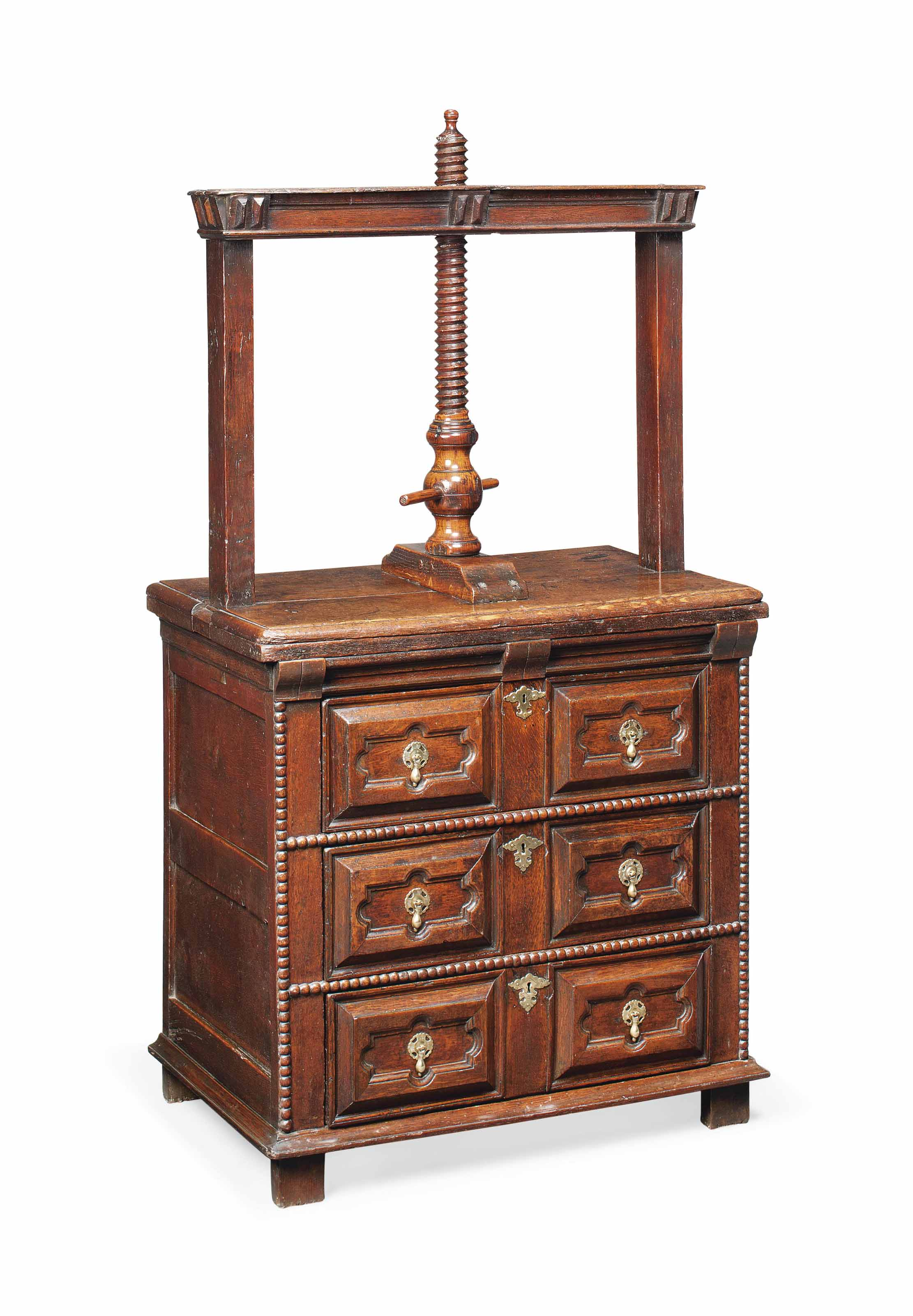 A WILLIAM AND MARY OAK CHEST WITH PRESS