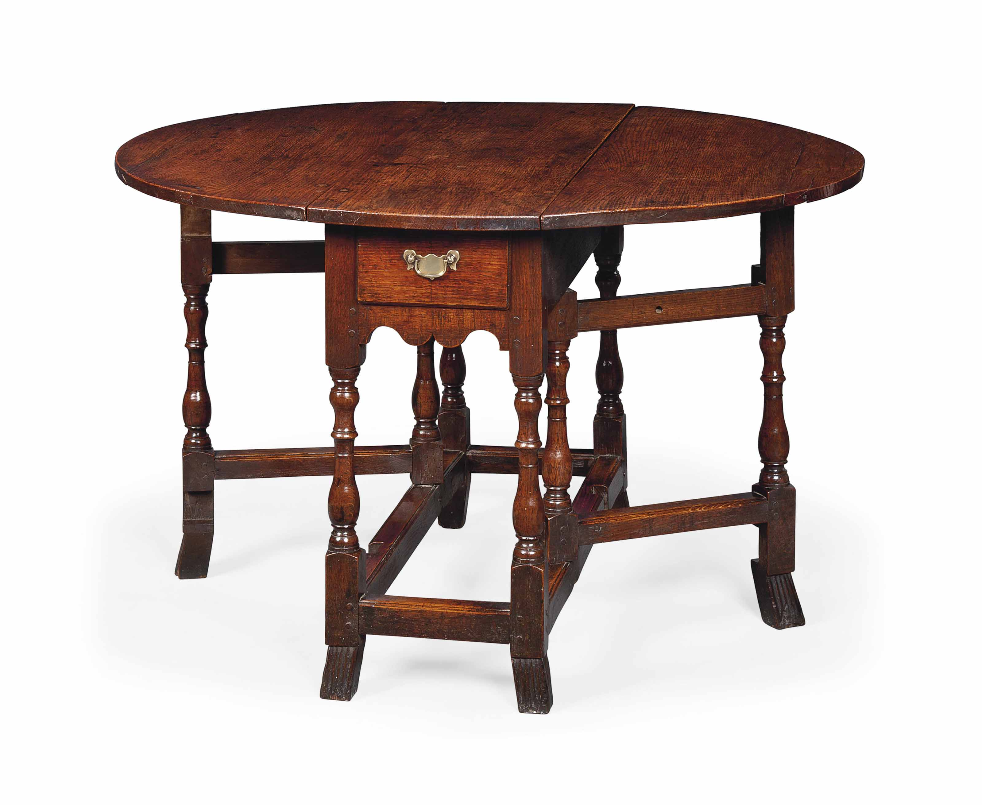 A GEORGE I OAK GATE-LEG TABLE
