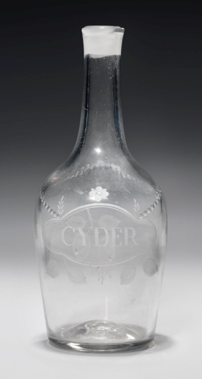 AN ENGRAVED GLASS CYDER DECANT