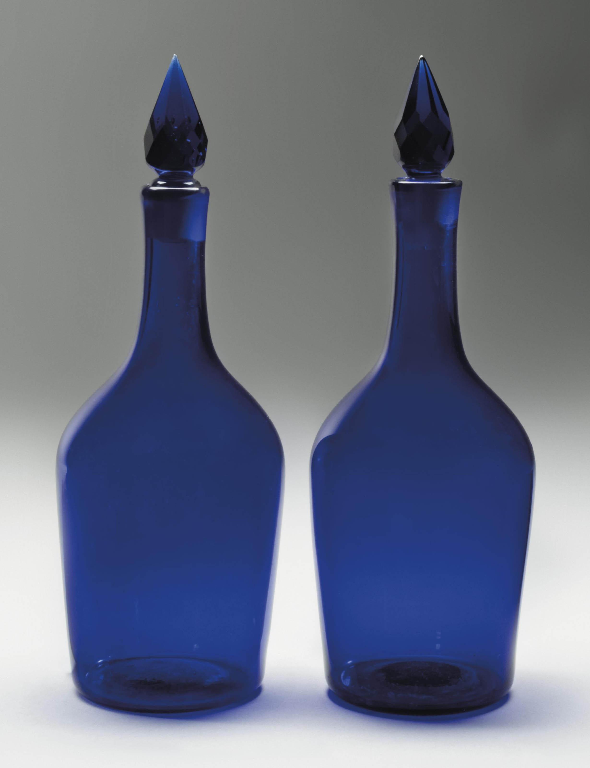 A PAIR OF BLUE GLASS CLUB-SHAP
