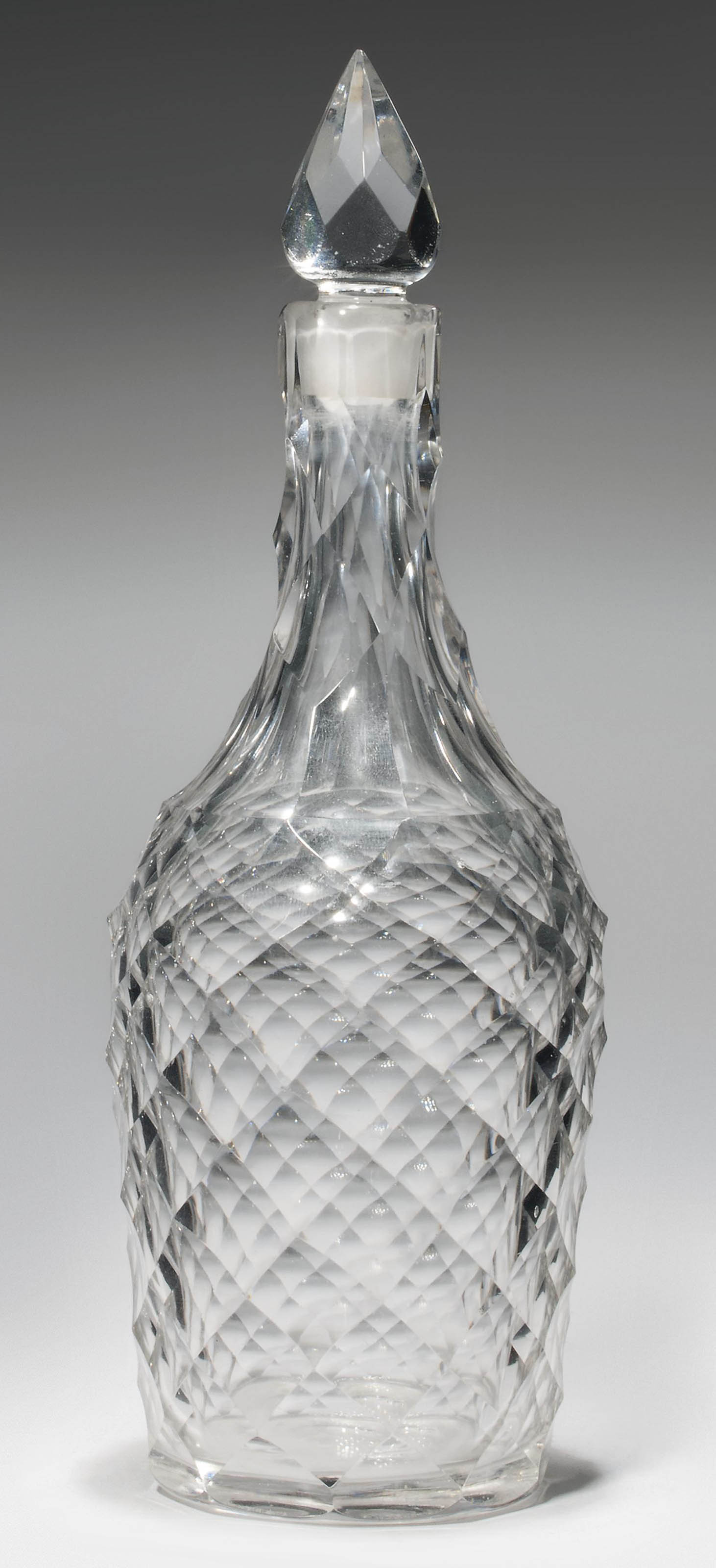 A CUT-GLASS DECANTER AND STOPP