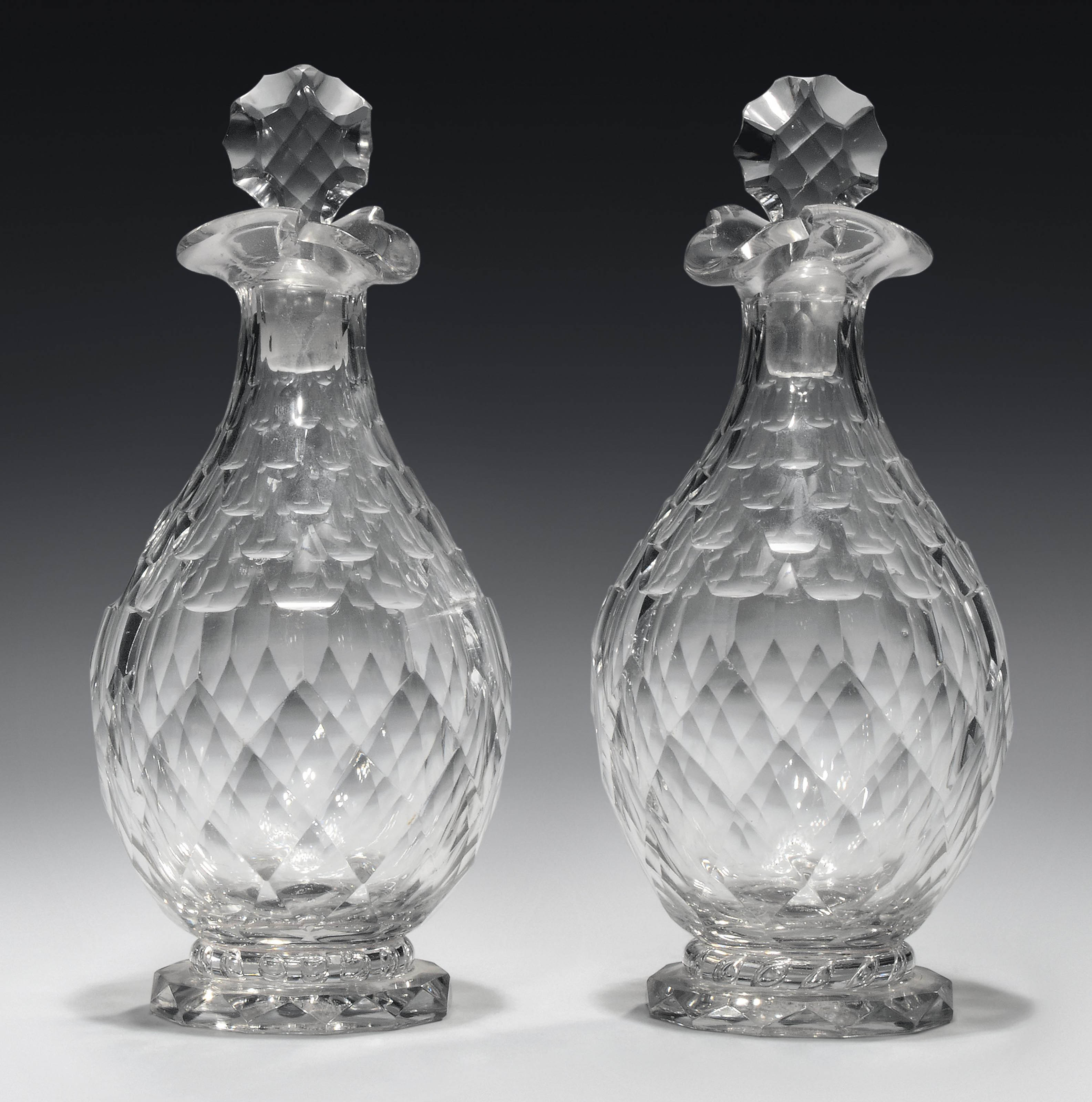A PAIR OF CUT GLASS POURING DE