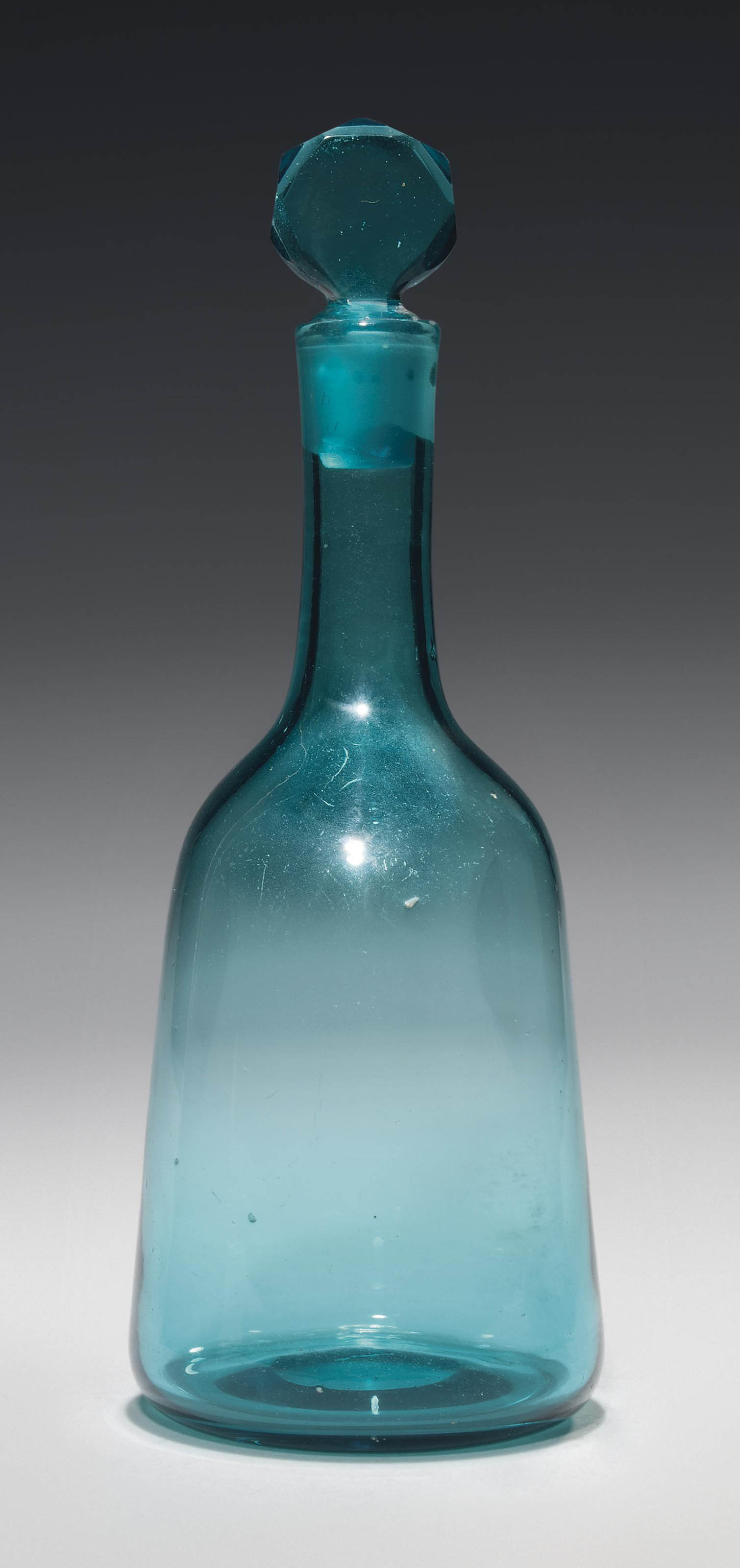 A PALE-GREEN-GLASS SPIRIT-DECANTER AND STOPPER