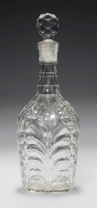 A CUT GLASS DECANTER AND STOPP