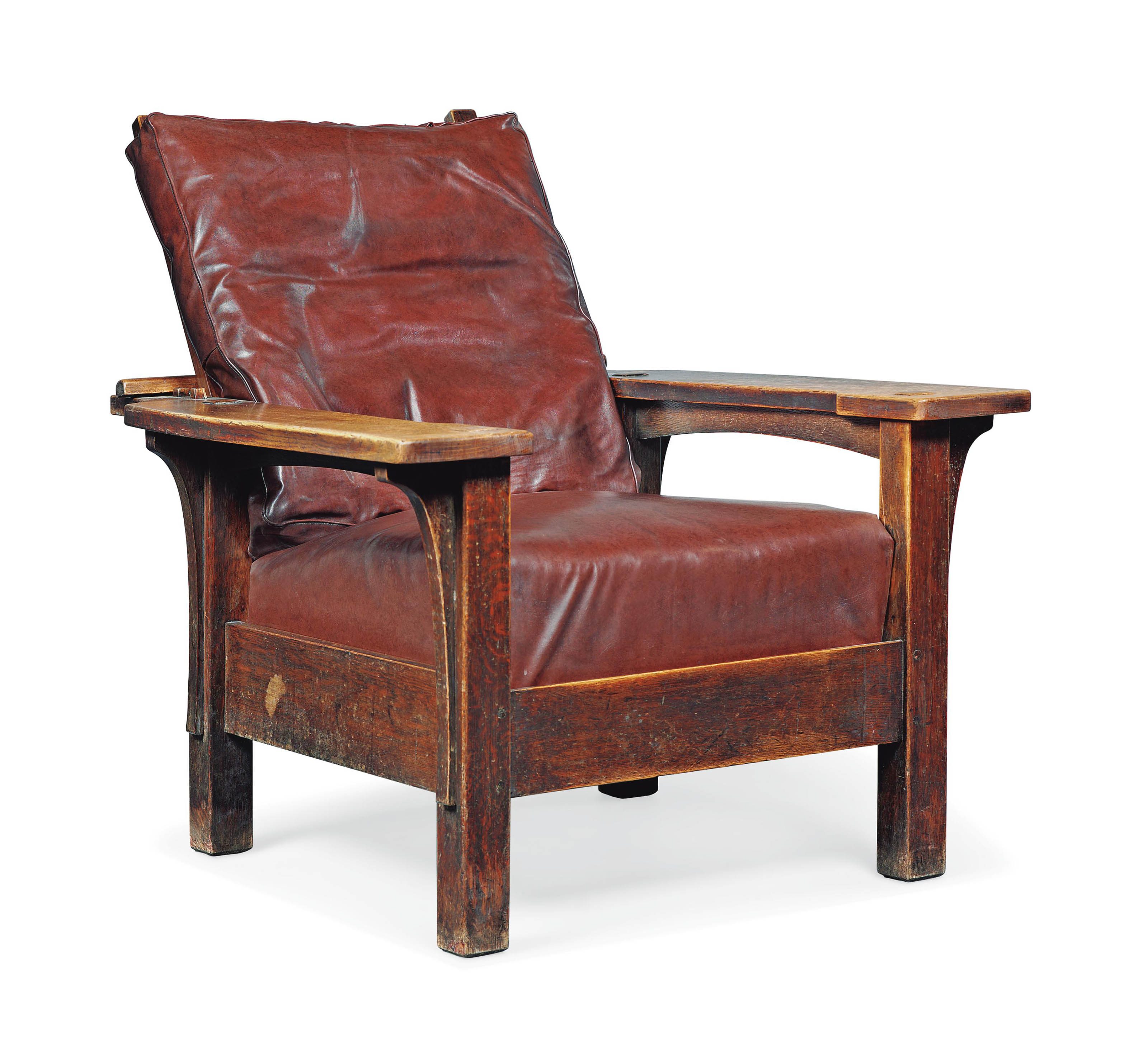 AN L. & J.G. STICKLEY STAINED OAK ADJUSTABLE ARMCHAIR, MODEL NO. 442