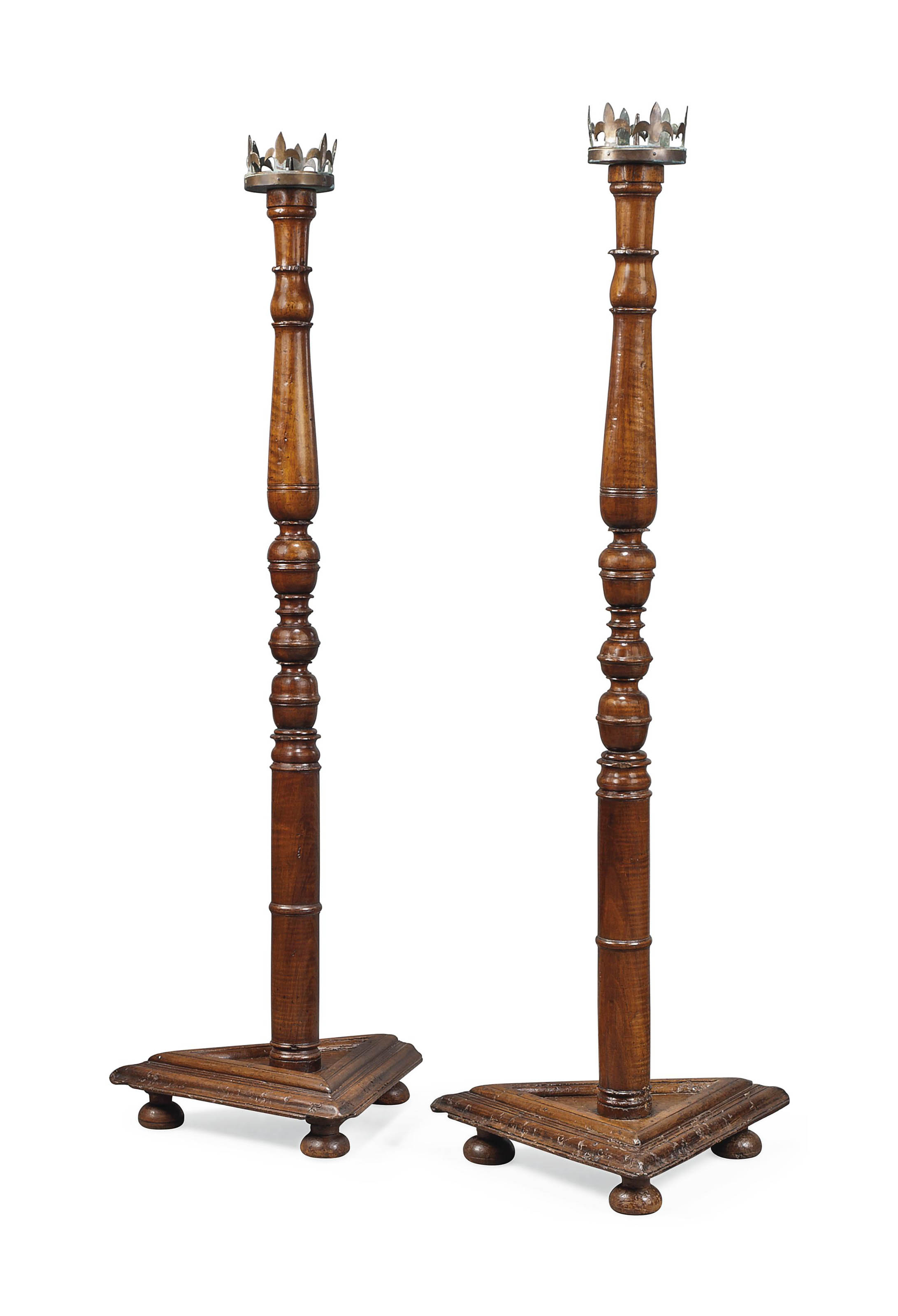 A PAIR OF WALNUT TORCHERES