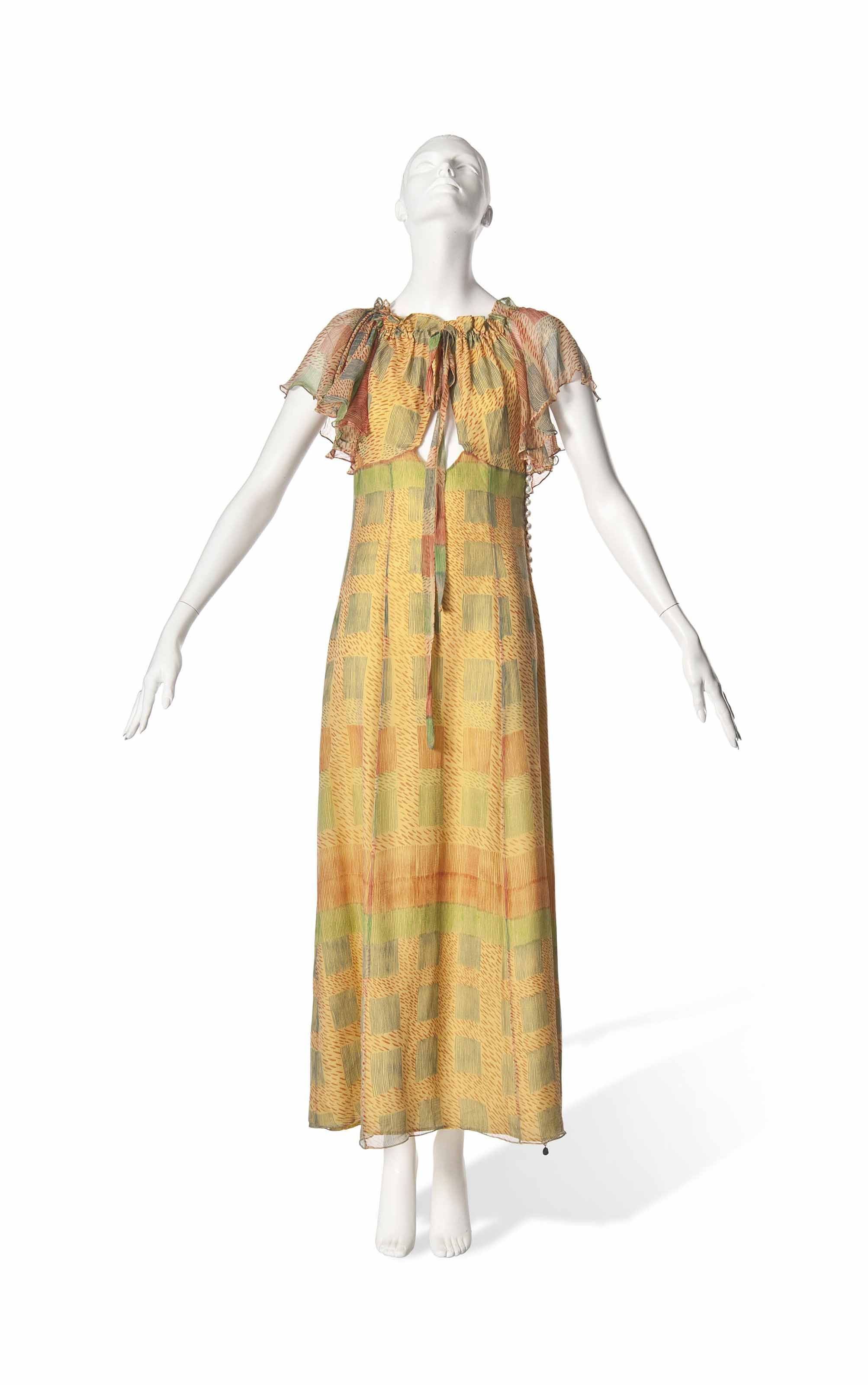 AN OSSIE CLARK AND CELIA BIRTWELL PRINTED CHIFFON, OFF-THE-SHOULDER MAXI DRESS