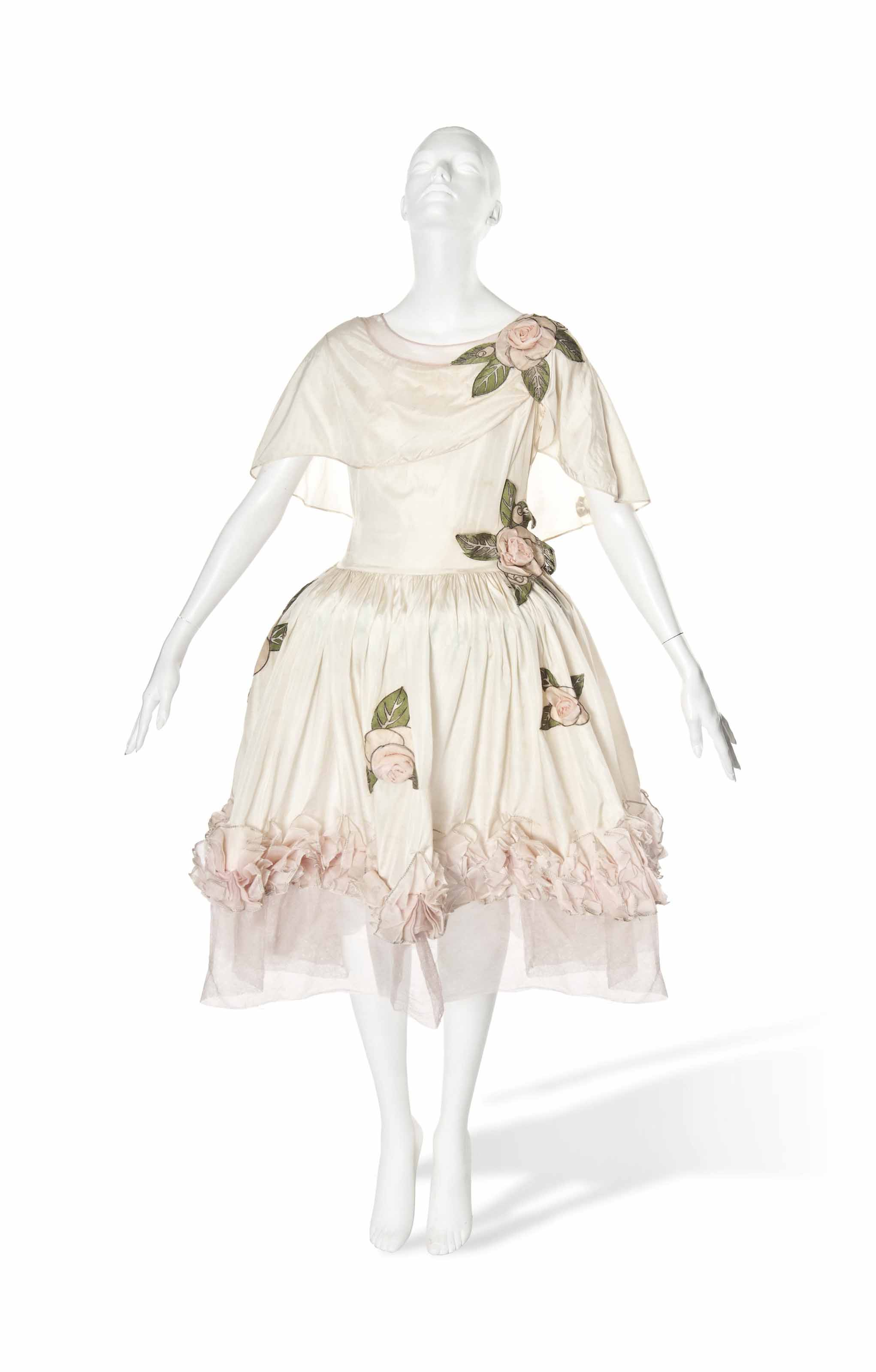A JEANNE LANVIN ROBE DE STYLE TRIMMED WITH ROSES