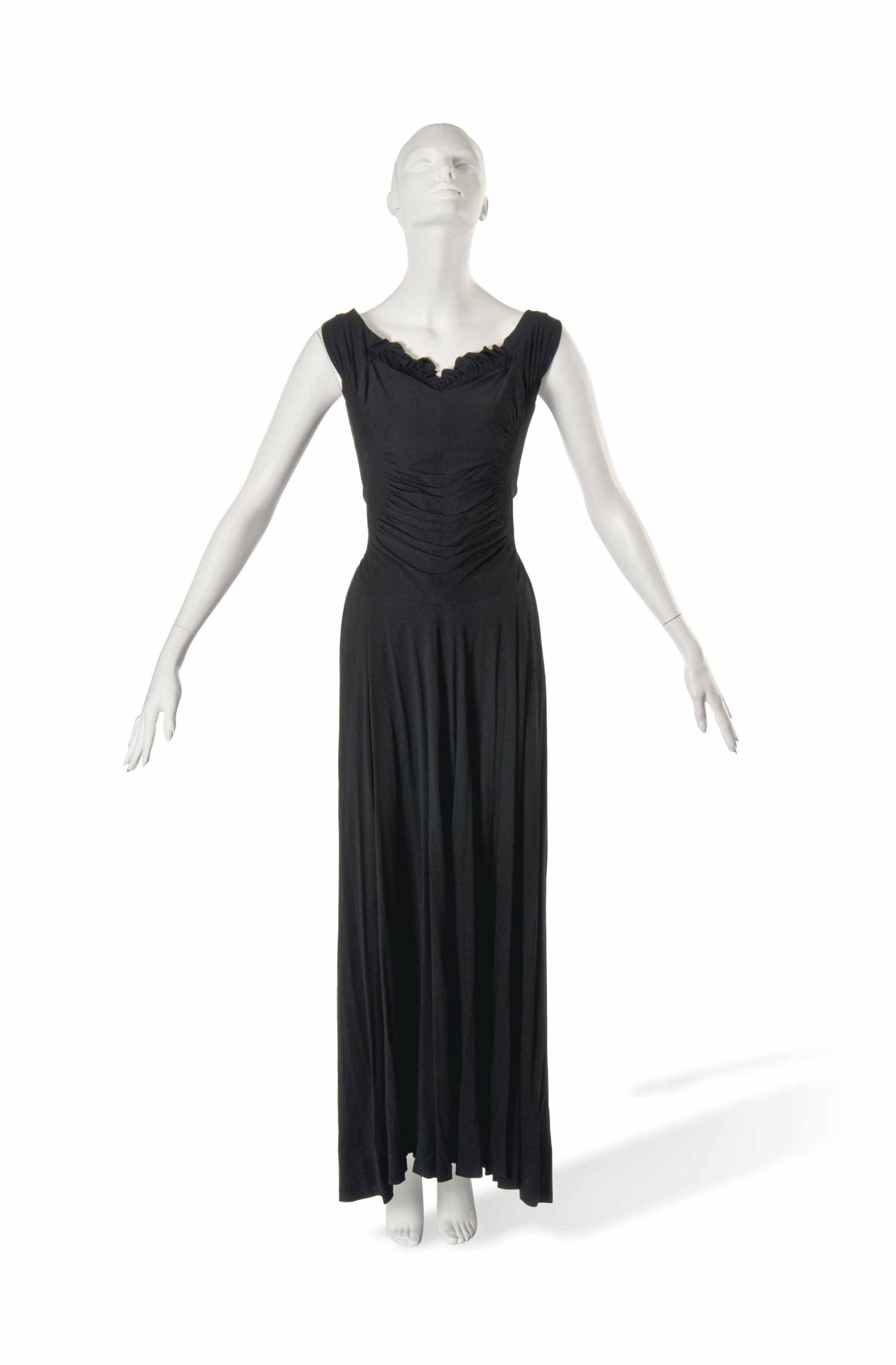 A PAQUIN BLACK SILK CREPE EVENING GOWN
