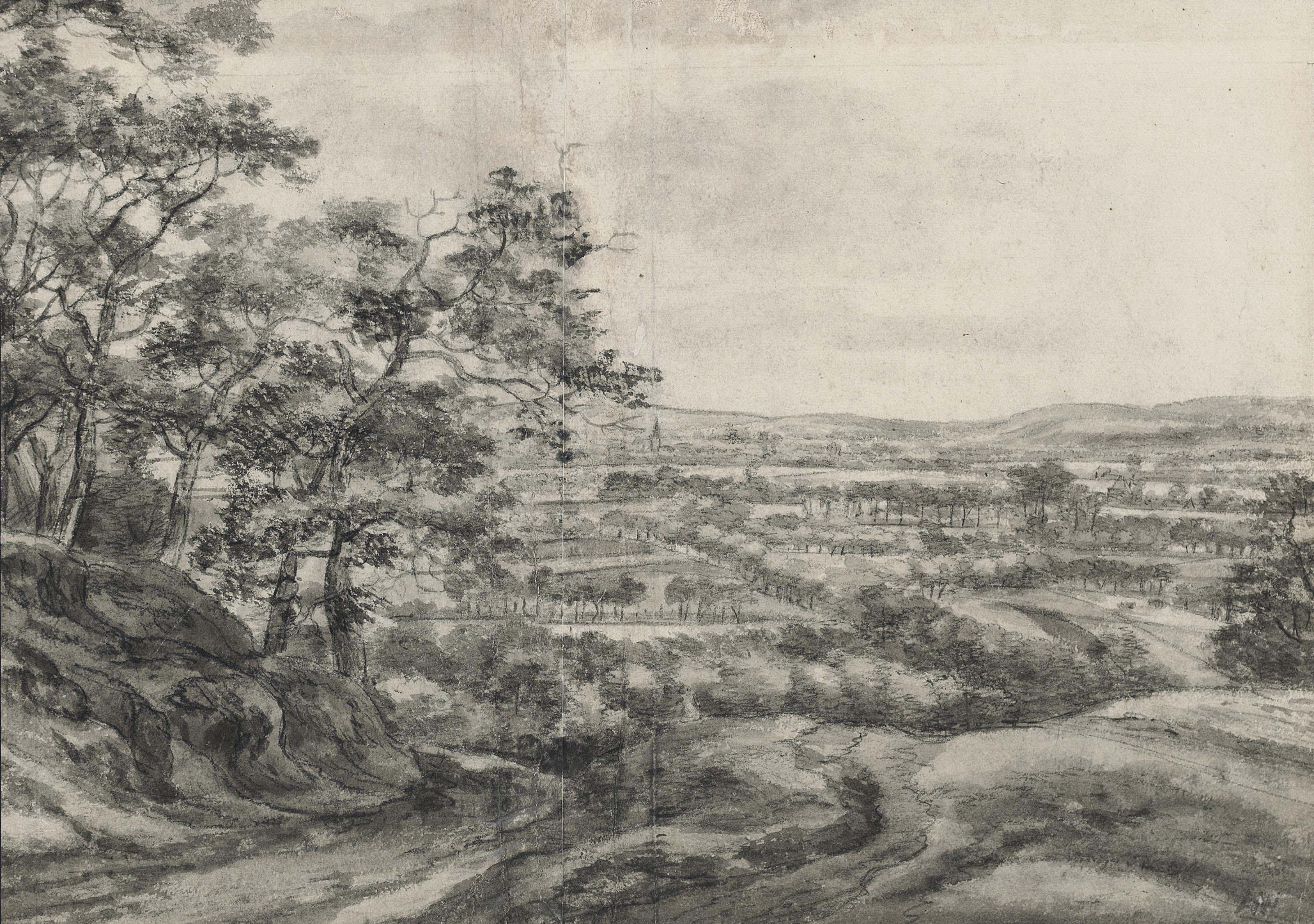 View of an extensive plain with a village in the distance