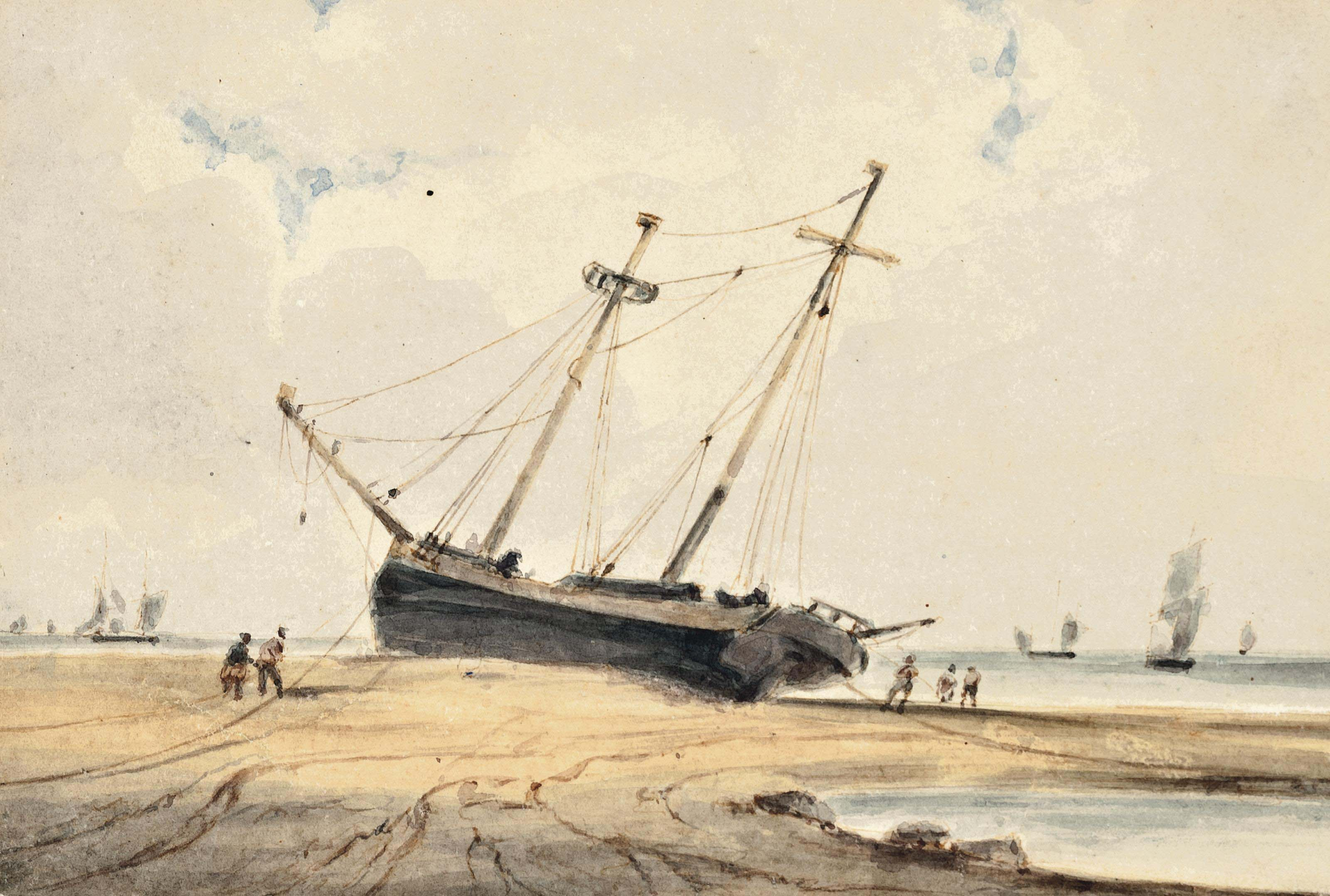 A beached vessel at low tide
