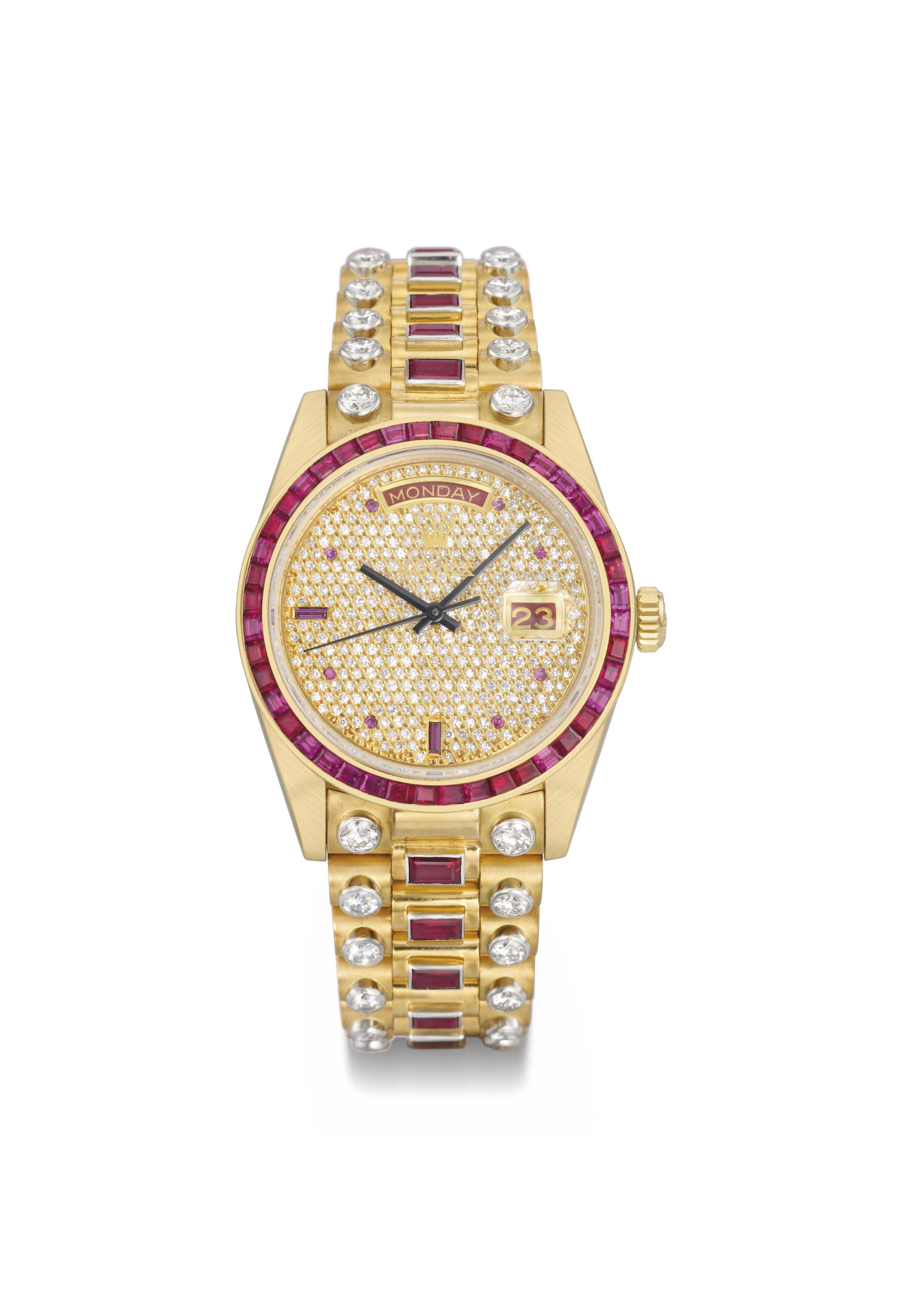b82bef2b135 Rolex. An extremely rare and attractive 18K gold, diamond and ruby-set  calendar wristwatch with sweep centre seconds and bracelet