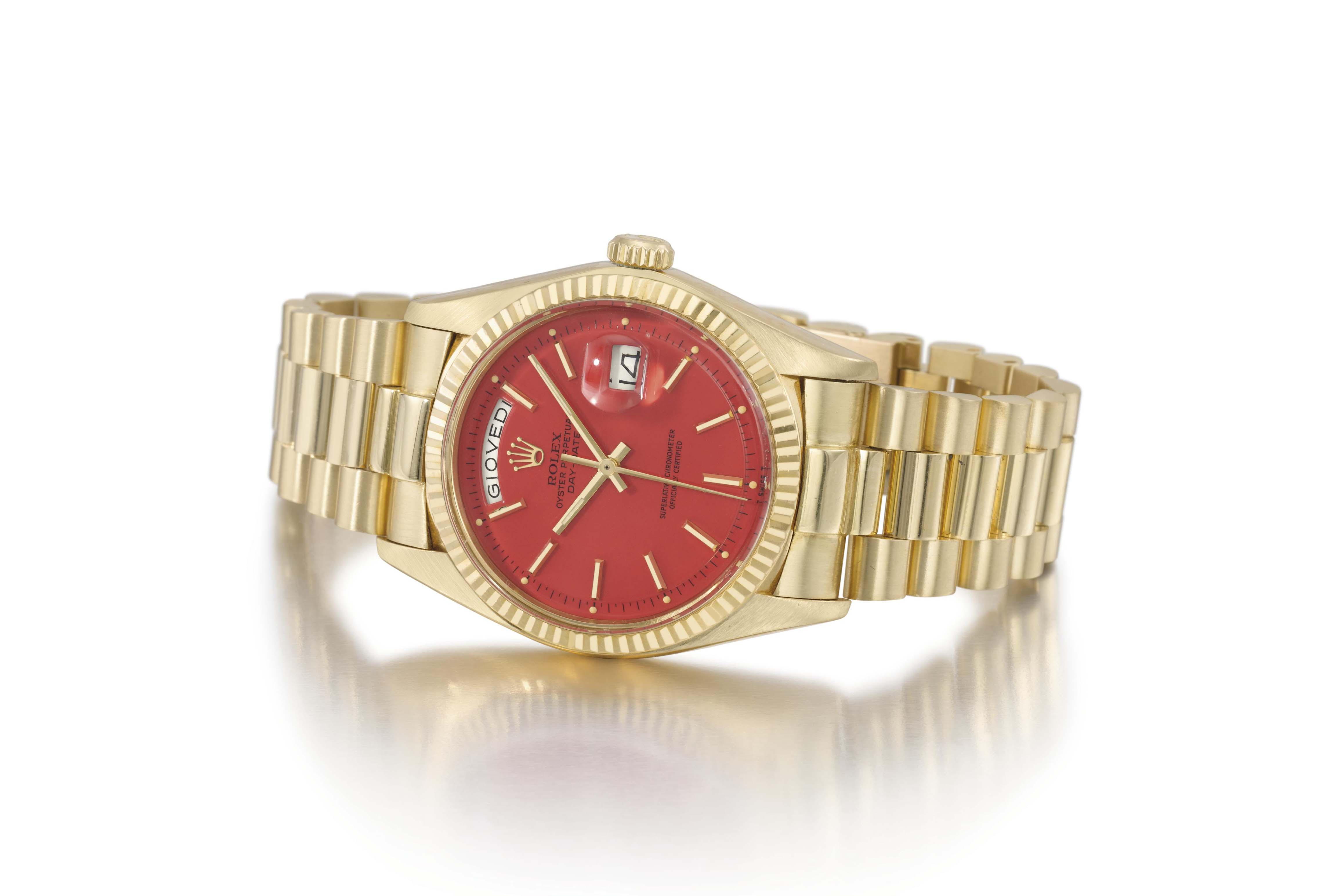 Rolex. An attractive 18K gold automatic calendar wristwatch with sweep centre seconds and coral-red lacquered dial