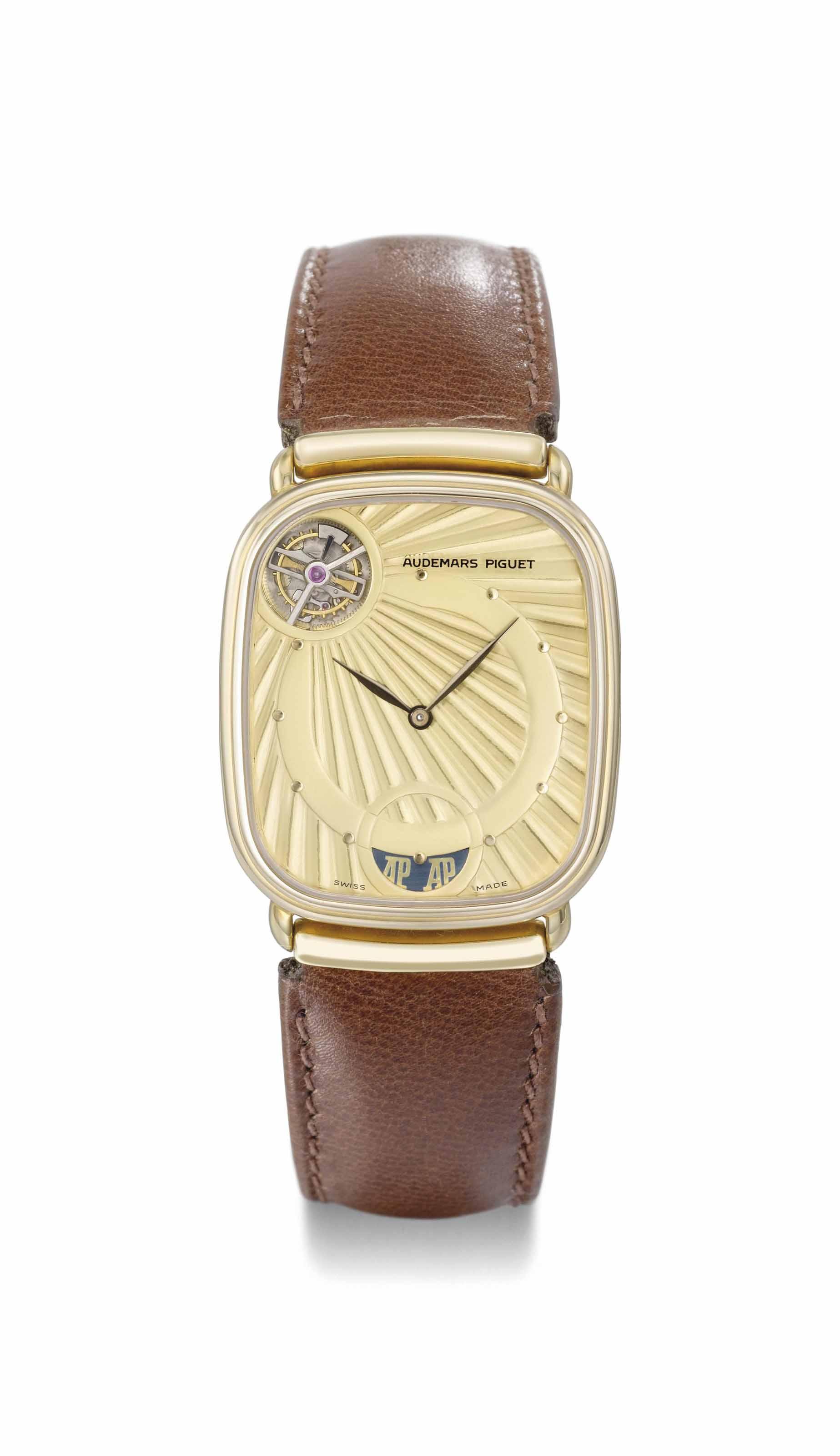 Audemars Piguet. A fine 18K gold thin automatic tourbillon wristwatch