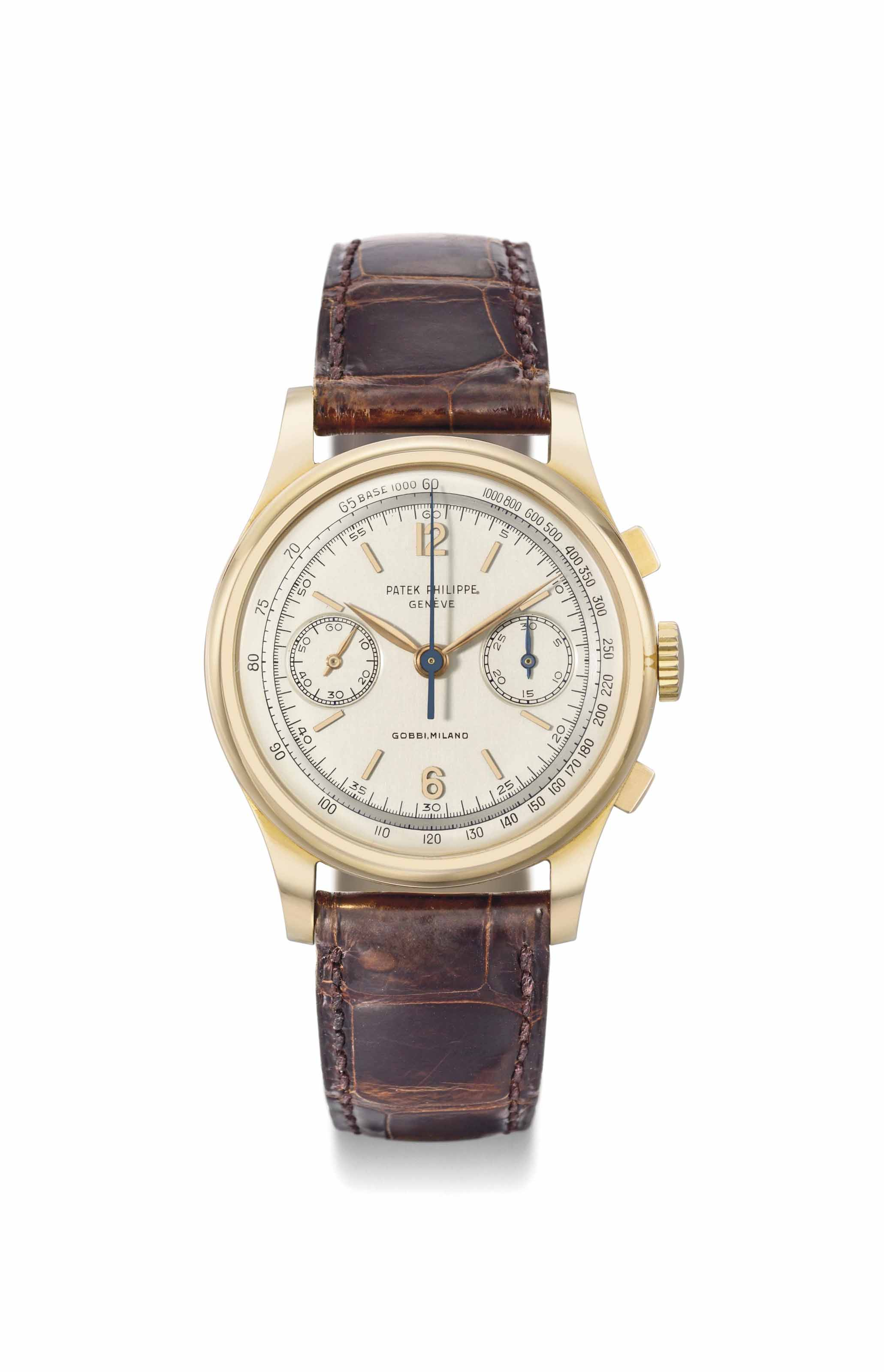 Patek Philippe. An extremely fine, rare and large 18K pink gold chronograph wristwatch with two-tone silvered dial