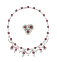 A RUBY AND DIAMOND NECKLACE, BY CHIAPPE, AND A BROOCH