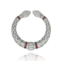 AN ART DECO RUBY AND DIAMOND BANGLE, BY LACLOCHE